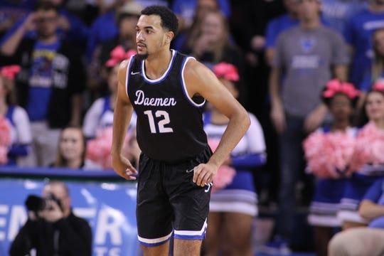 Elmira Notre Dame graduate Darius Garvin competes for Daemen College's men's basketball team.