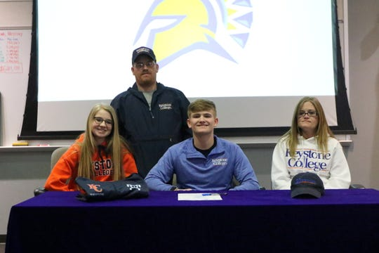 Thomas A. Edison senior Tyler Lewis with his parents, Matt and Karrie Lewis, and sister, Kaylee, during a signing ceremony March 13, 2019 at Edison High School.