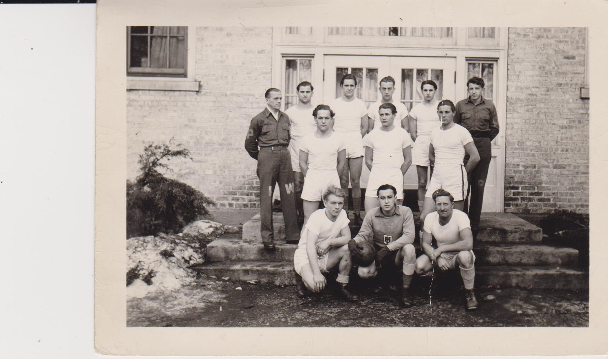 During his time at Camp Hartford, Kurt Pechmann was part of a soccer team. In this photo from January 1945, the soccer team is pictured, with Pechmann seen on the left side of the middle row.