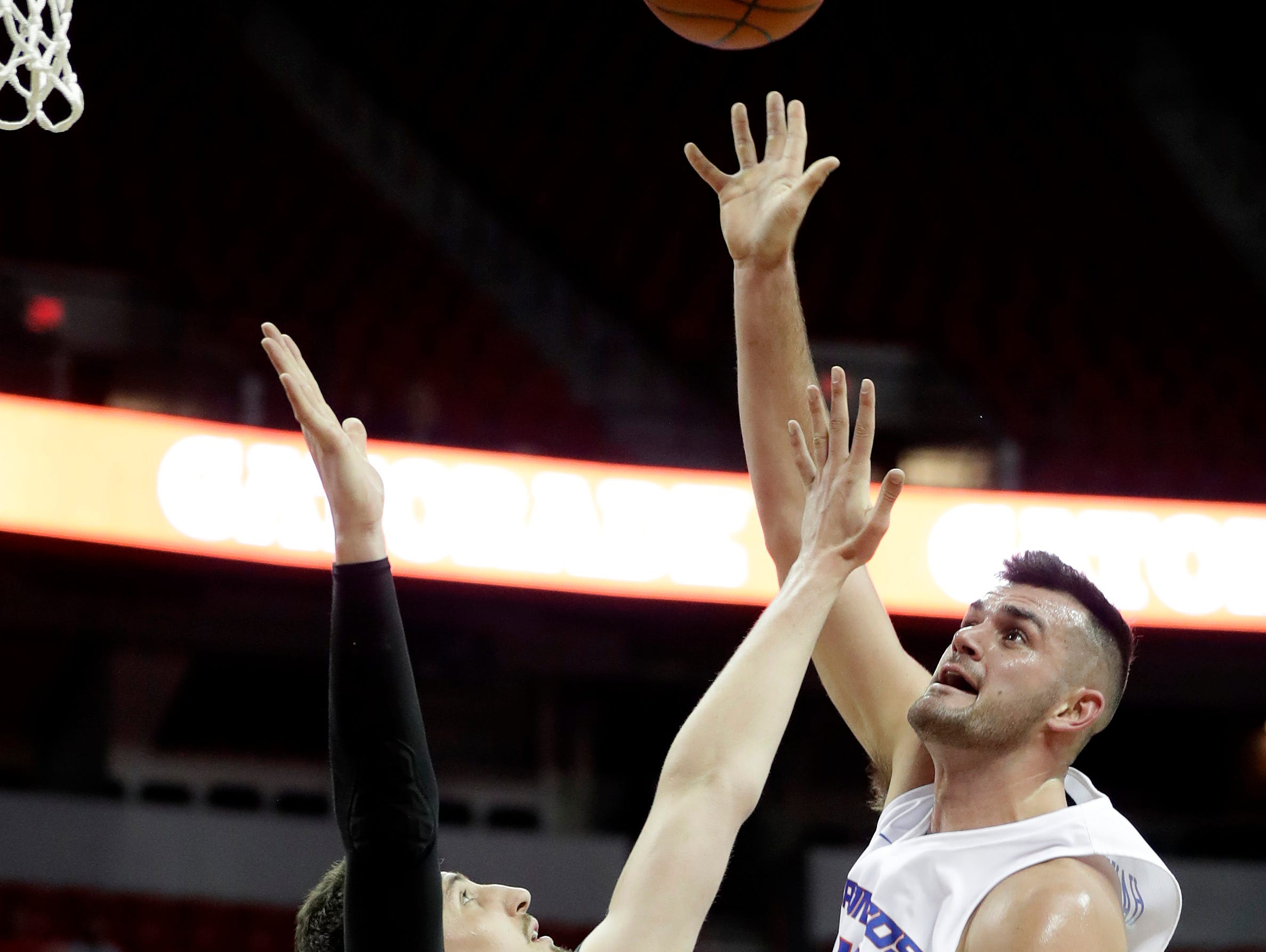 Boise State's Zach Haney, right, shoots over Colorado State's Nico Carvacho (32) during the first half of an NCAA college basketball game in the Mountain West Conference tournament, Wednesday, March 13, 2019, in Las Vegas.