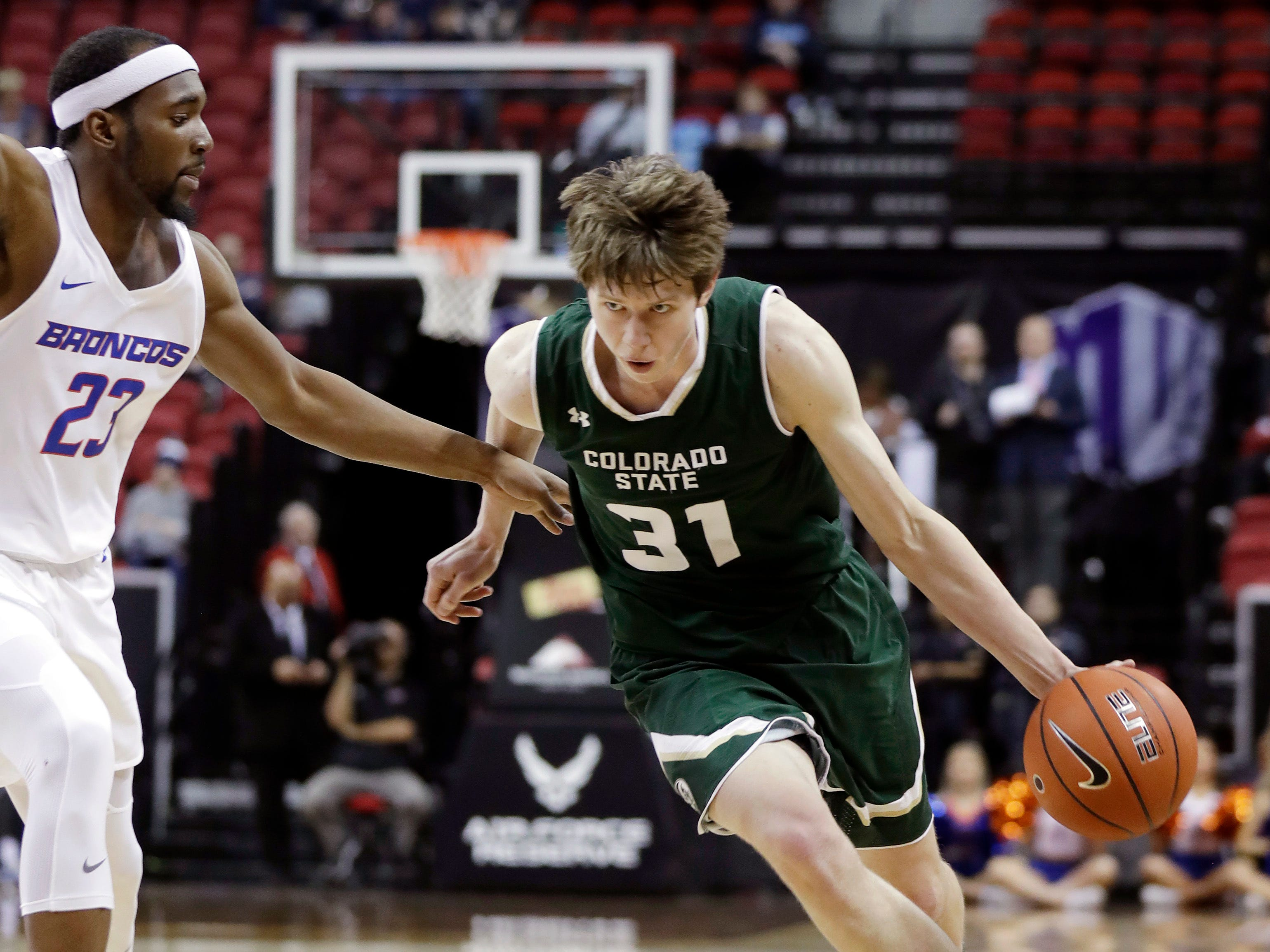 Colorado State's Adam Thistlewood (31) drives past Boise State's Roderick Williams (23) during the second half of an NCAA college basketball game in the Mountain West Conference tournament, Wednesday, March 13, 2019, in Las Vegas.