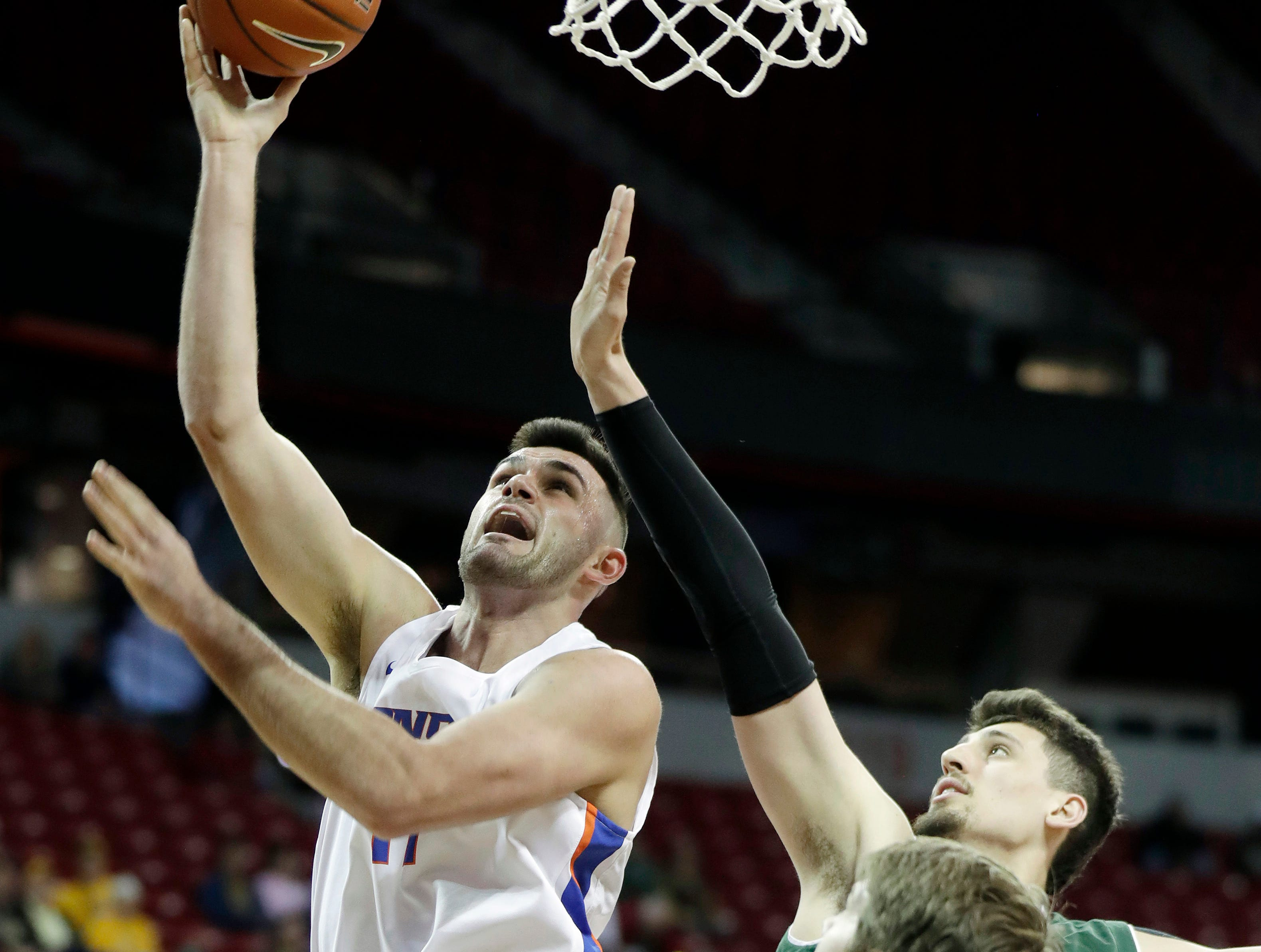 Colorado State's Nico Carvacho defends as Boise State's Zach Haney, left, shoots during the first half of an NCAA college basketball game in the Mountain West Conference tournament Wednesday, March 13, 2019, in Las Vegas.