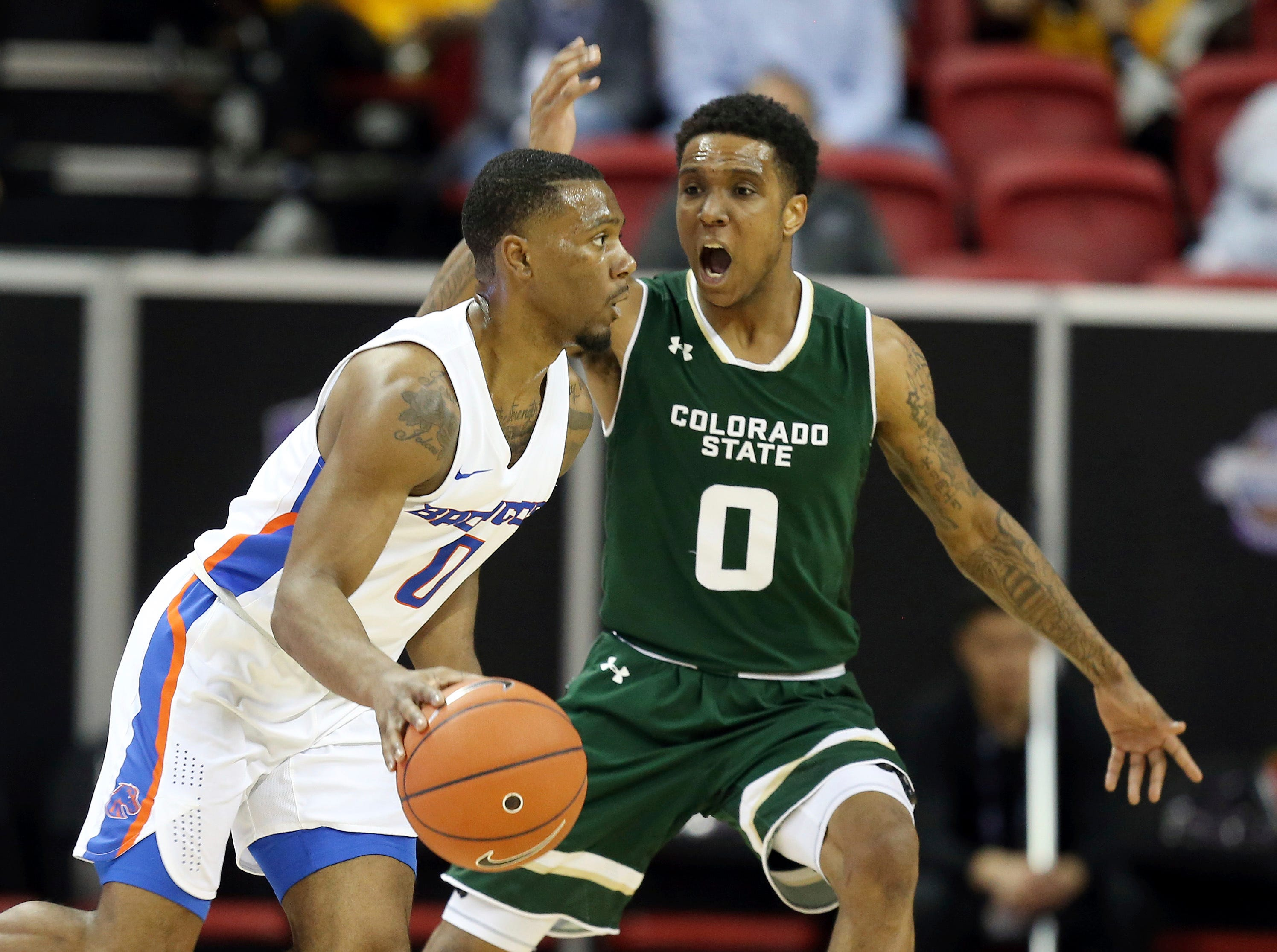 Colorado State's Hyron Edwards (0) defends as Boise State's Marcus Dickinson drives during the second half of an NCAA college basketball game in the Mountain West Conference tournament Wednesday, March 13, 2019, in Las Vegas.