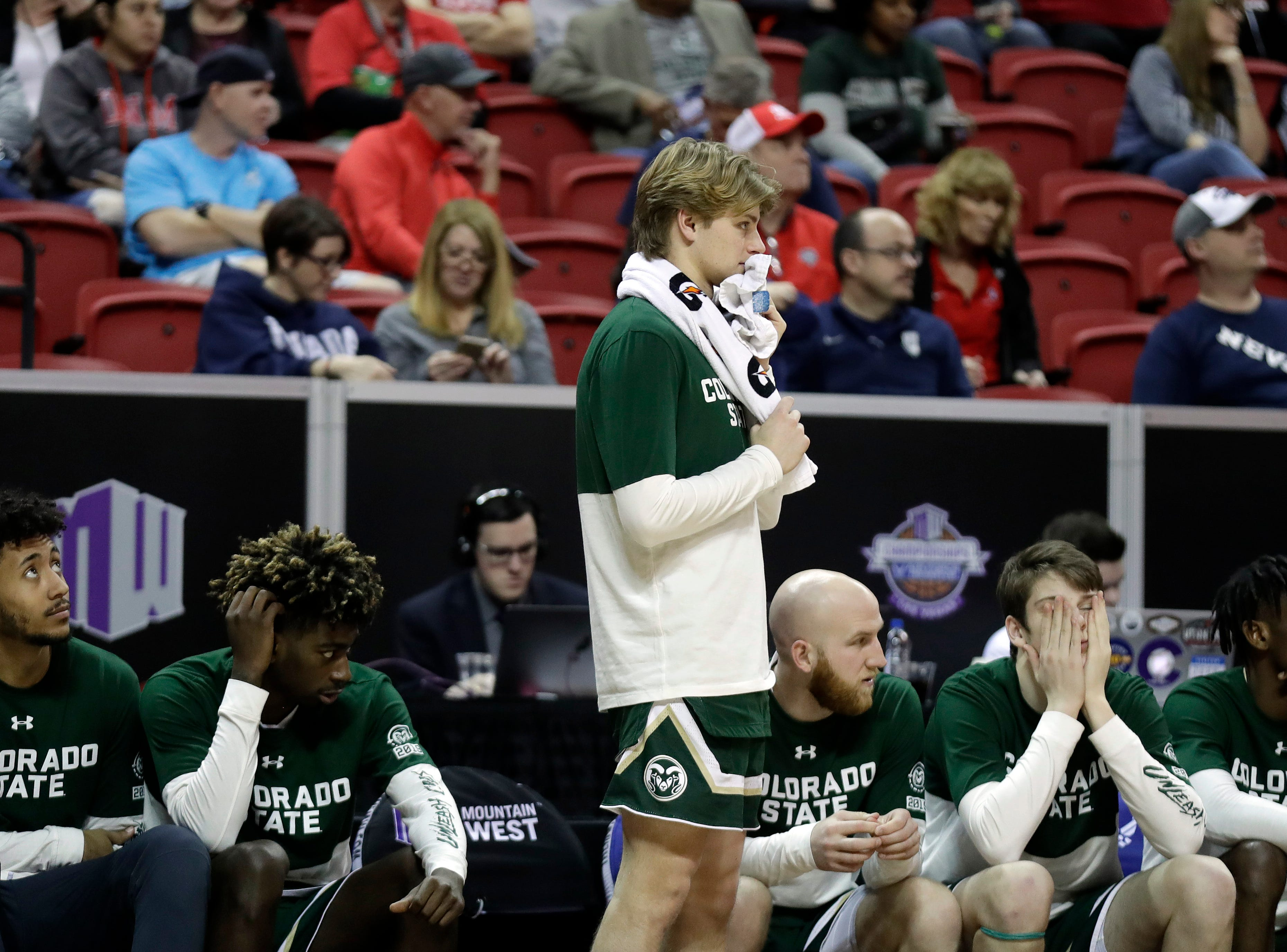 The Colorado State bench watches during the final minutes of the second half of an NCAA college basketball game in the Mountain West Conference tournament against Boise State Wednesday, March 13, 2019, in Las Vegas.