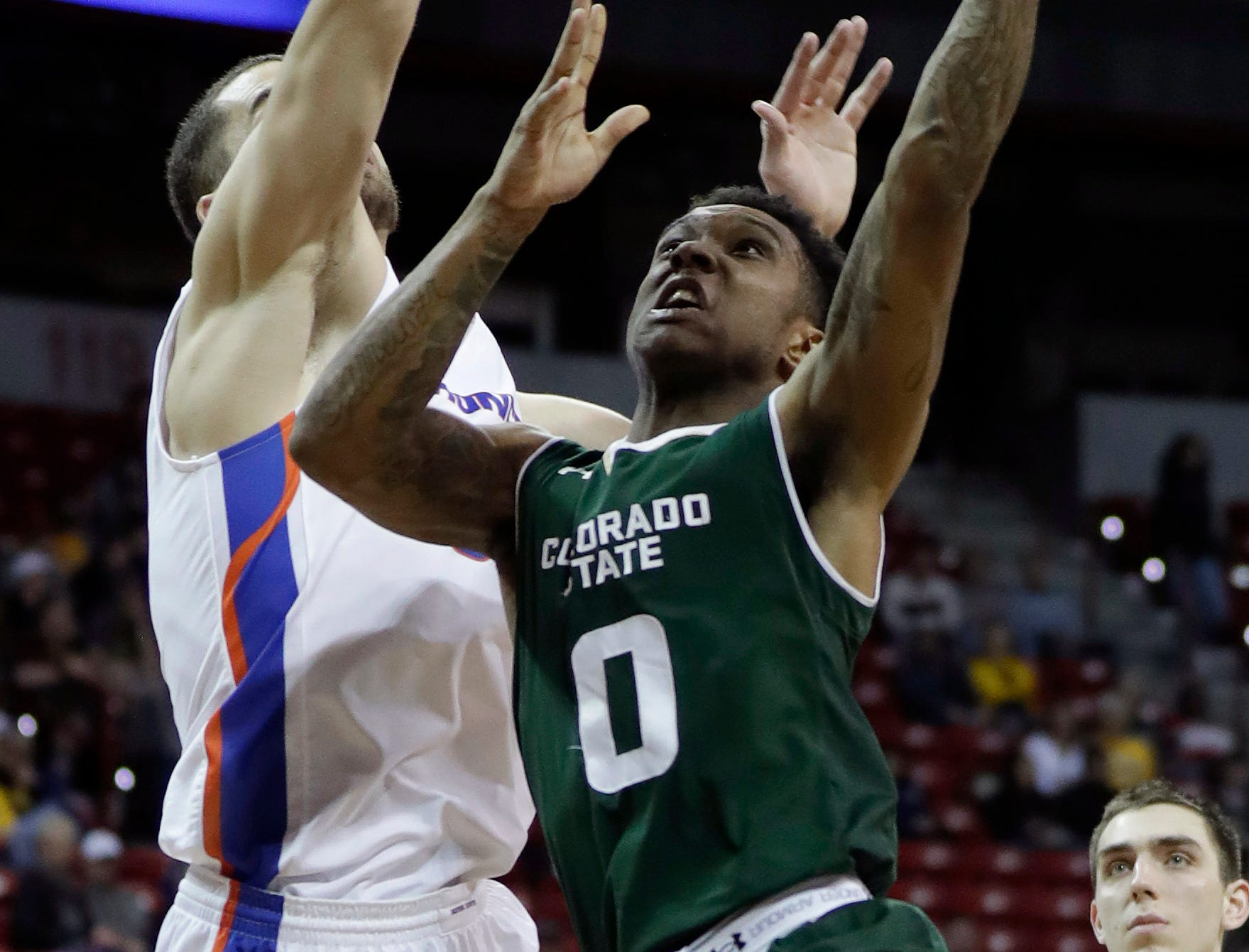 Colorado State's Hyron Edwards (0) shoots as Boise State's David Wacker defends during the second half of an NCAA college basketball game in the Mountain West Conference tournament, Wednesday, March 13, 2019, in Las Vegas.