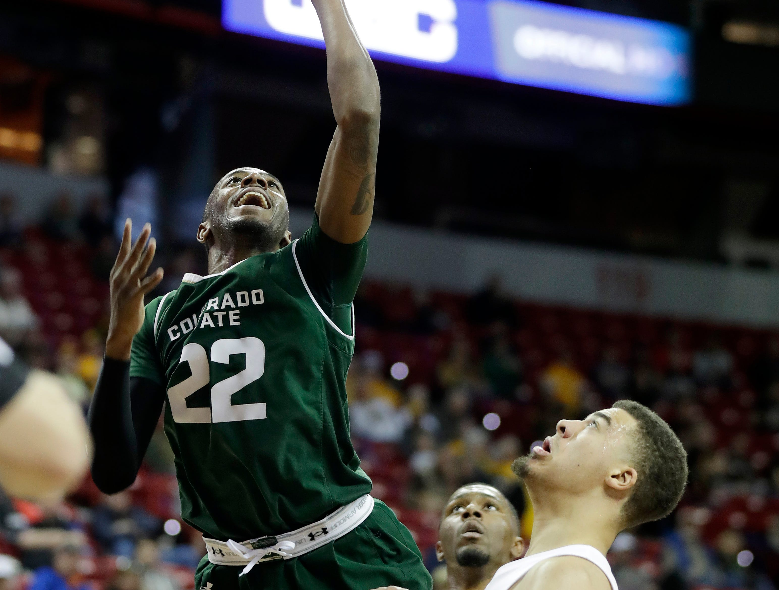 Colorado State's J.D. Paige shoots over Boise State's Alex Hobbs during the second half of an NCAA college basketball game in the Mountain West Conference tournament Wednesday, March 13, 2019, in Las Vegas.