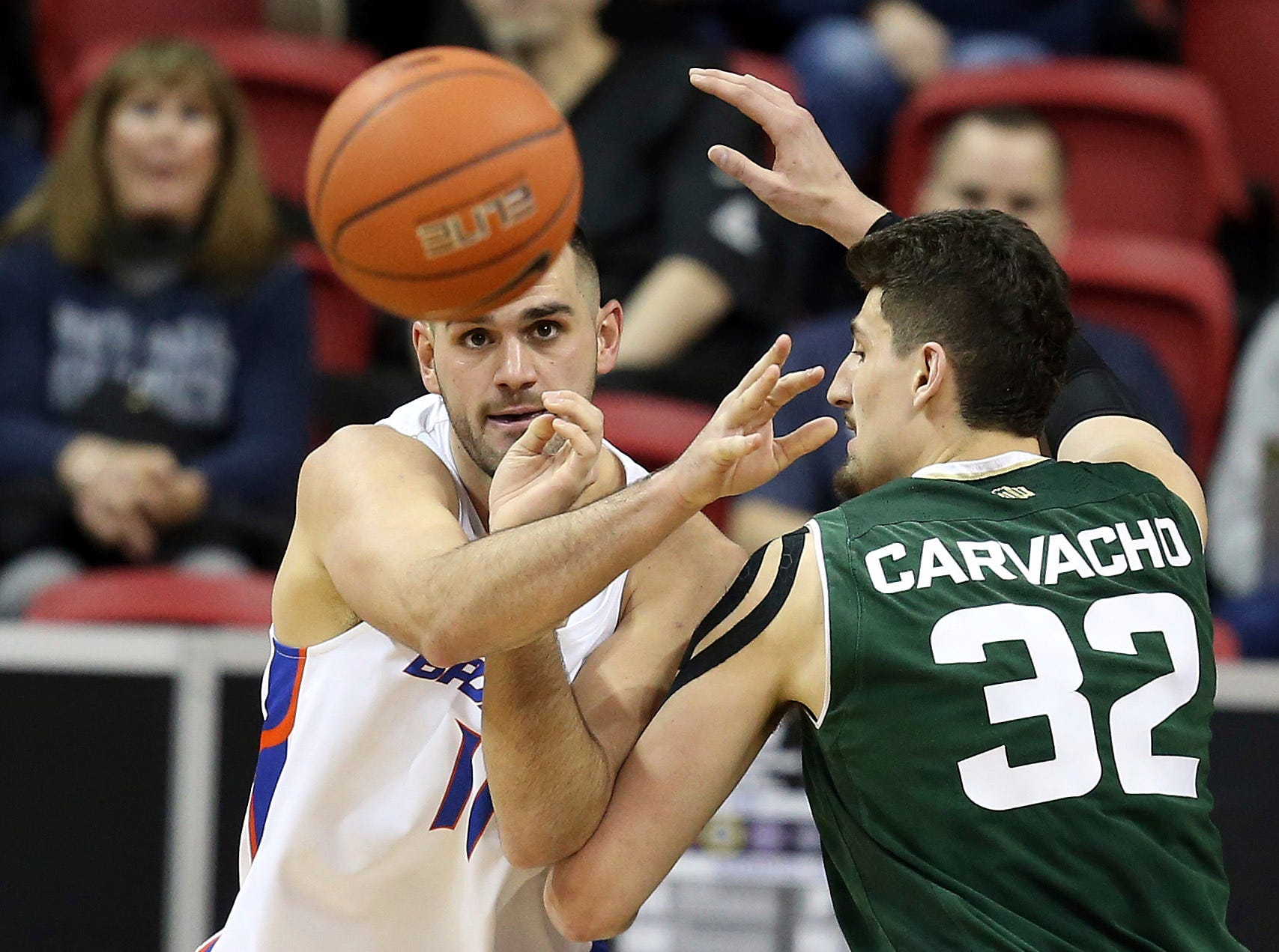 Colorado State's Nico Carvacho (32) defends as Boise State's Zach Haney (11) passes during the second half of an NCAA college basketball game in the Mountain West Conference tournament Wednesday, March 13, 2019, in Las Vegas.