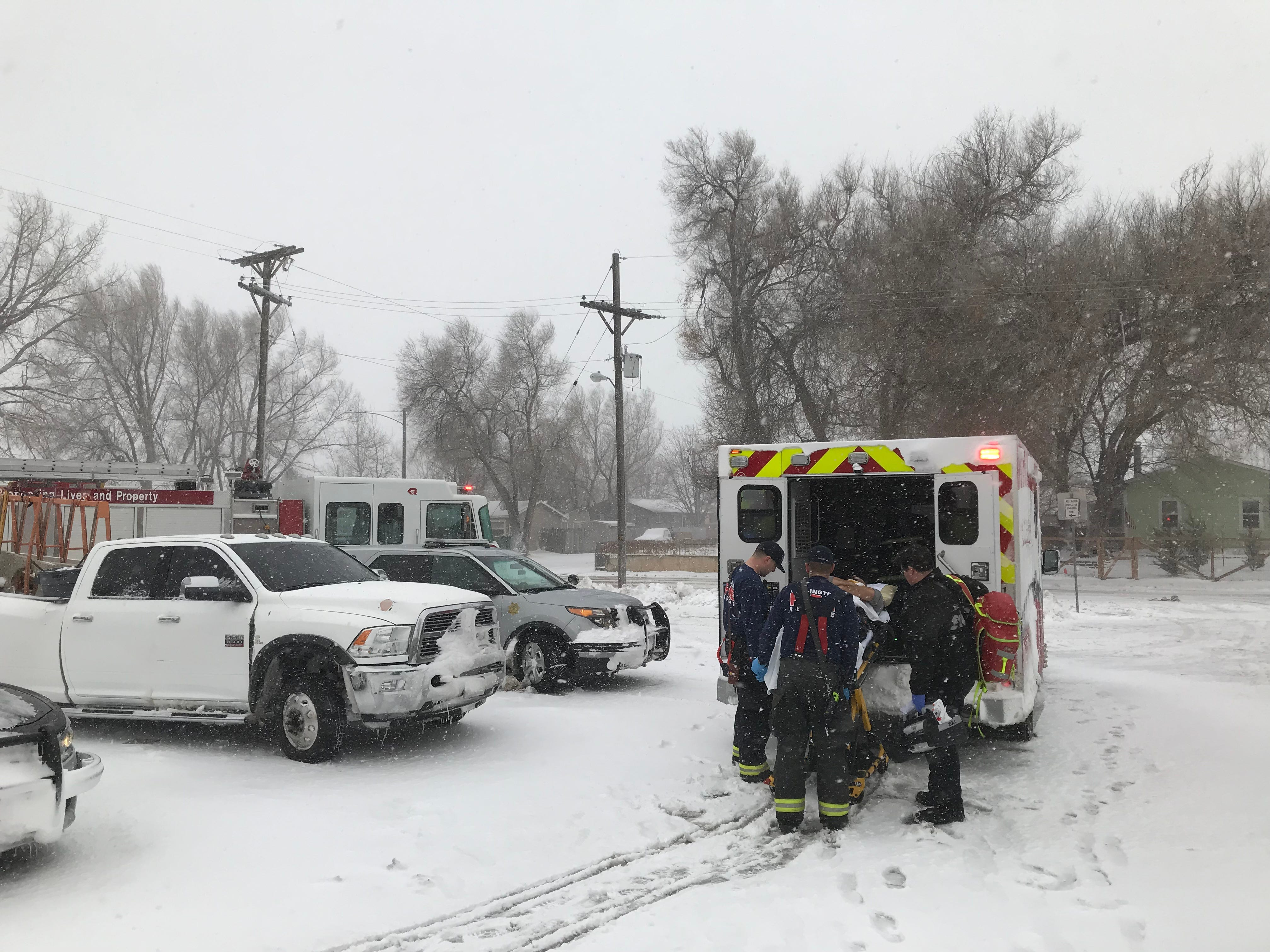 A person injured in a crash near Wellington is loaded into an ambulance at the Leeper Center during the bomb cyclone blizzard on Wednesday, March 13, 2019.