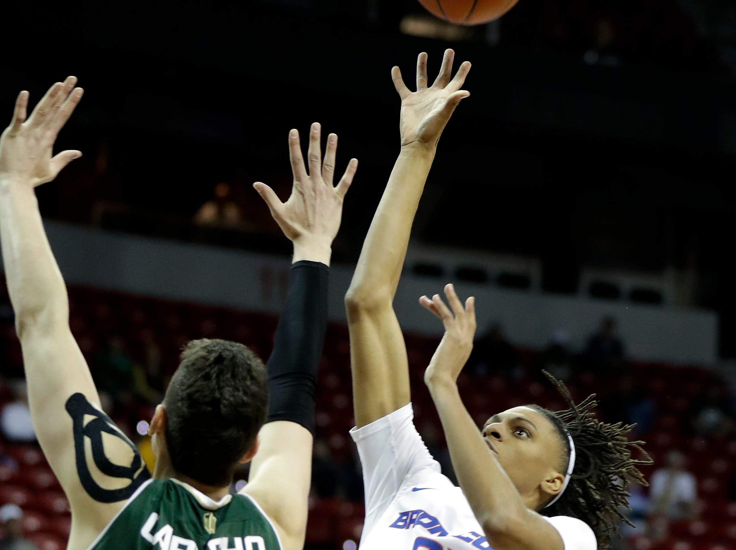 Colorado State's Nico Carvacho (32) covers a shot from Boise State's Derrick Alston (21) during the first half of an NCAA college basketball game in the Mountain West Conference tournament, Wednesday, March 13, 2019, in Las Vegas.
