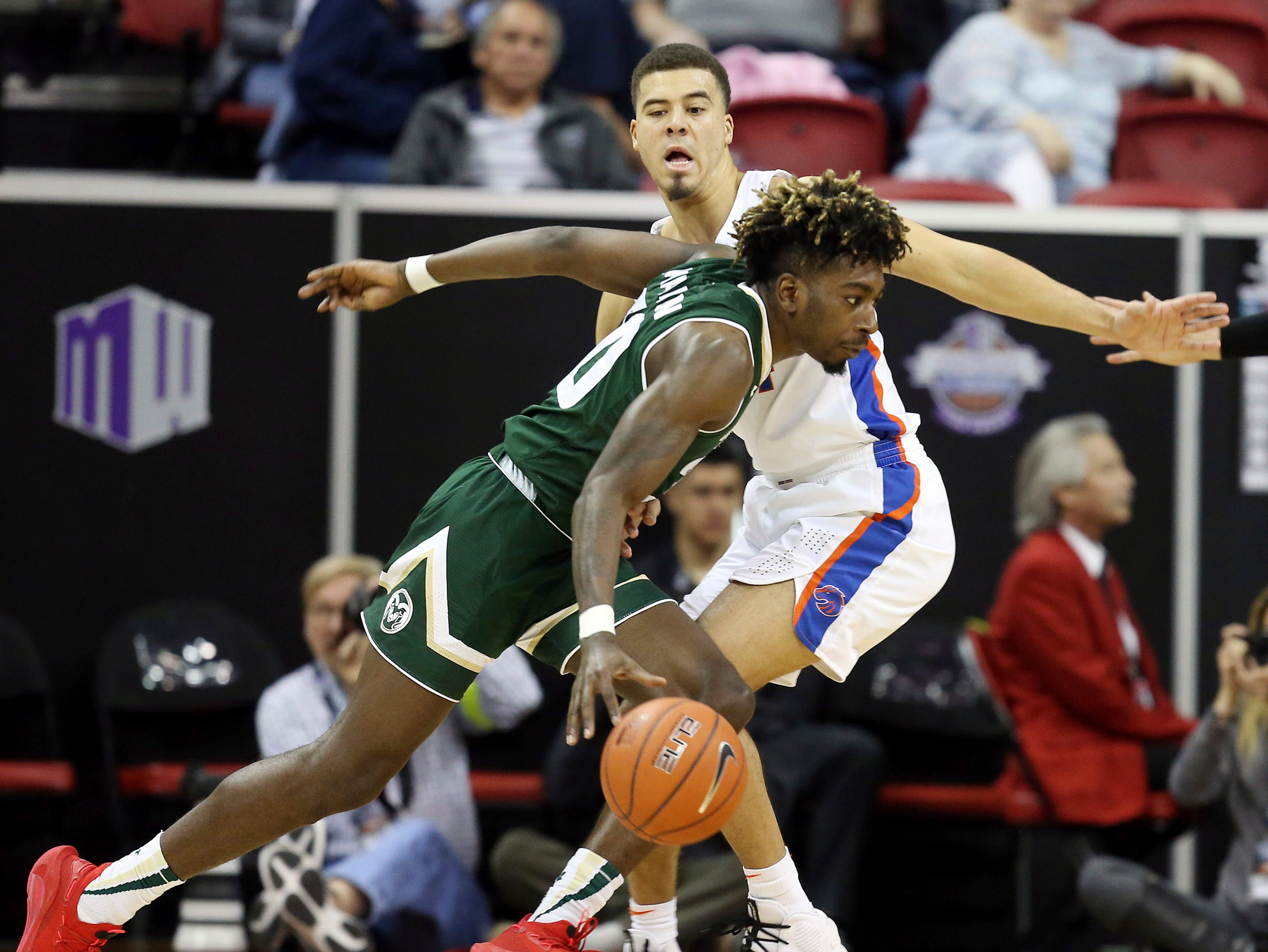 Colorado State's Kris Martin drives defended by Boise State's Alex Hobbs during the first half of an NCAA college basketball game in the Mountain West Conference tournament, Wednesday, March 13, 2019, in Las Vegas.