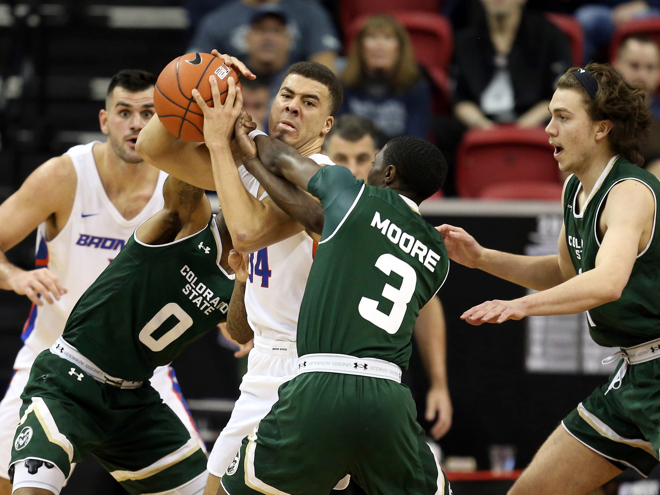 Colorado State's Kendle Moore (3) and Boise State's Alex Hobbs (34) struggle for a loose ball during the second half of an NCAA college basketball game in the Mountain West Conference tournament Wednesday, March 13, 2019, in Las Vegas.