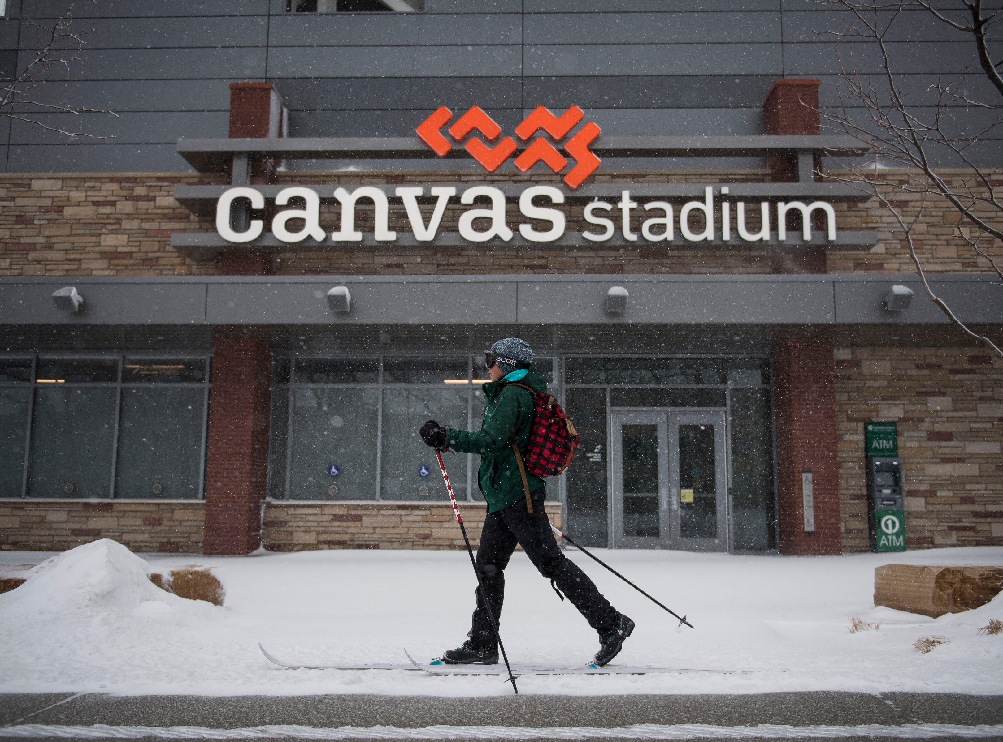 CSU art major Saskia Becker cross-country skis past Canvas Stadium on Wednesday, March 13, 2019, in Fort Collins, Colo.