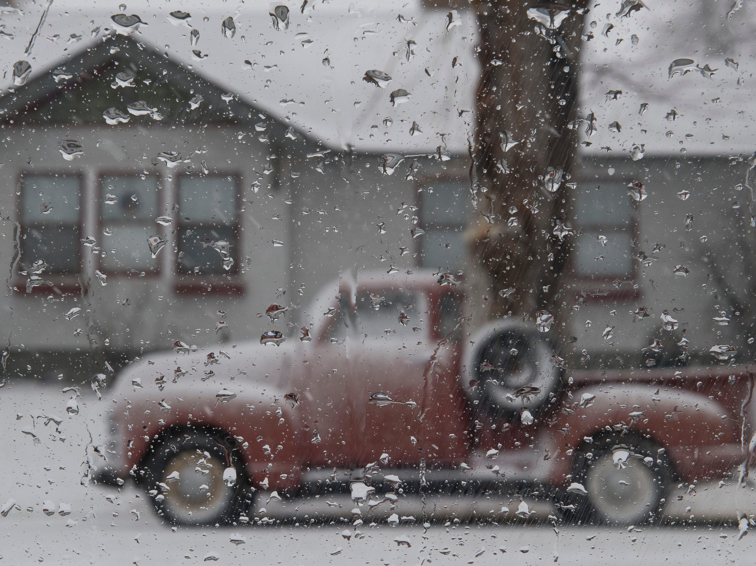 A classic truck collects snow on Wednesday, March 13, 2019, in Fort Collins, Colo.