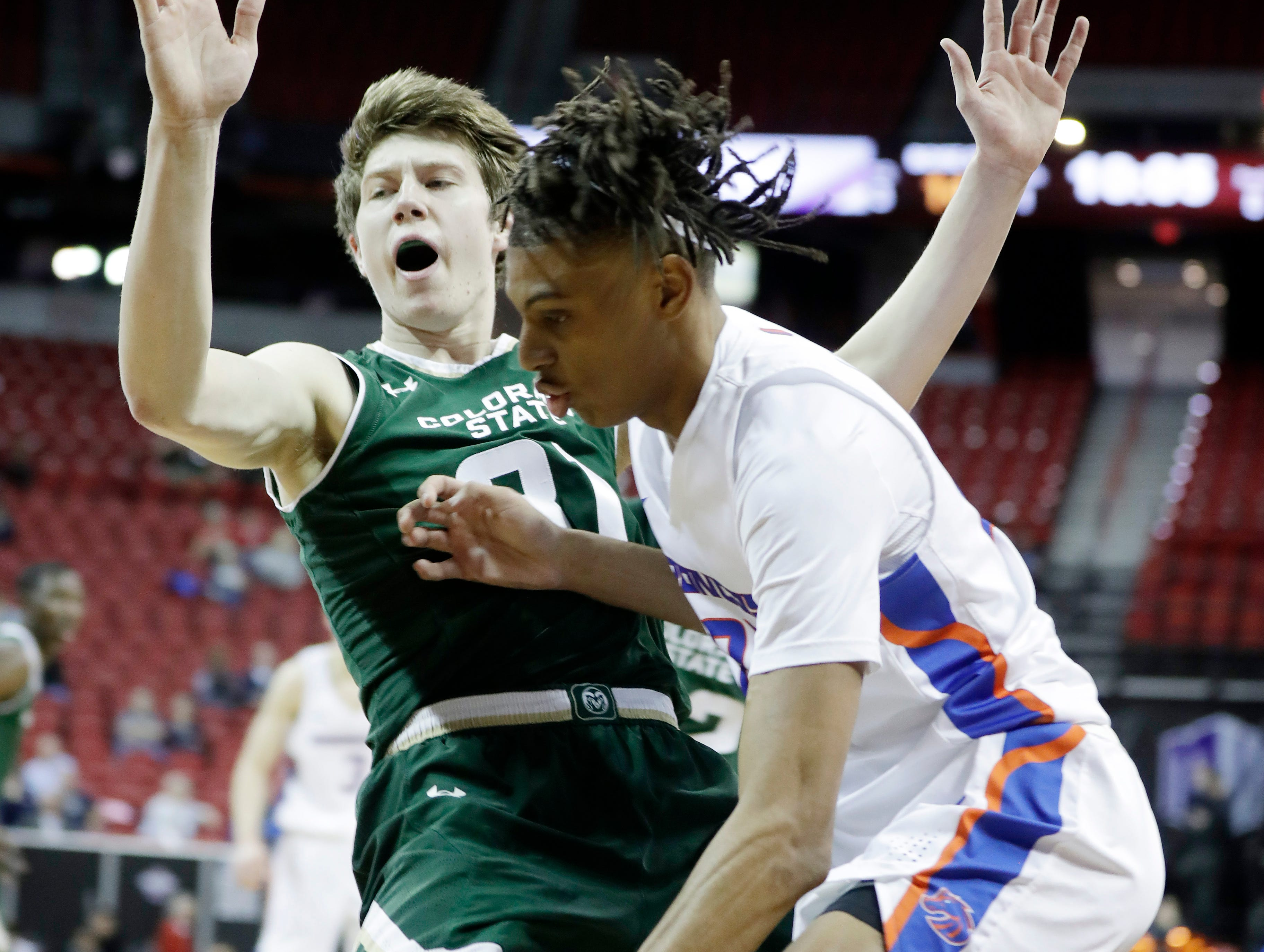 Colorado State's Adam Thistlewood (31) defends against a drive from Boise State's Derrick Alston during the first half of an NCAA college basketball game in the Mountain West Conference tournament, Wednesday, March 13, 2019, in Las Vegas.