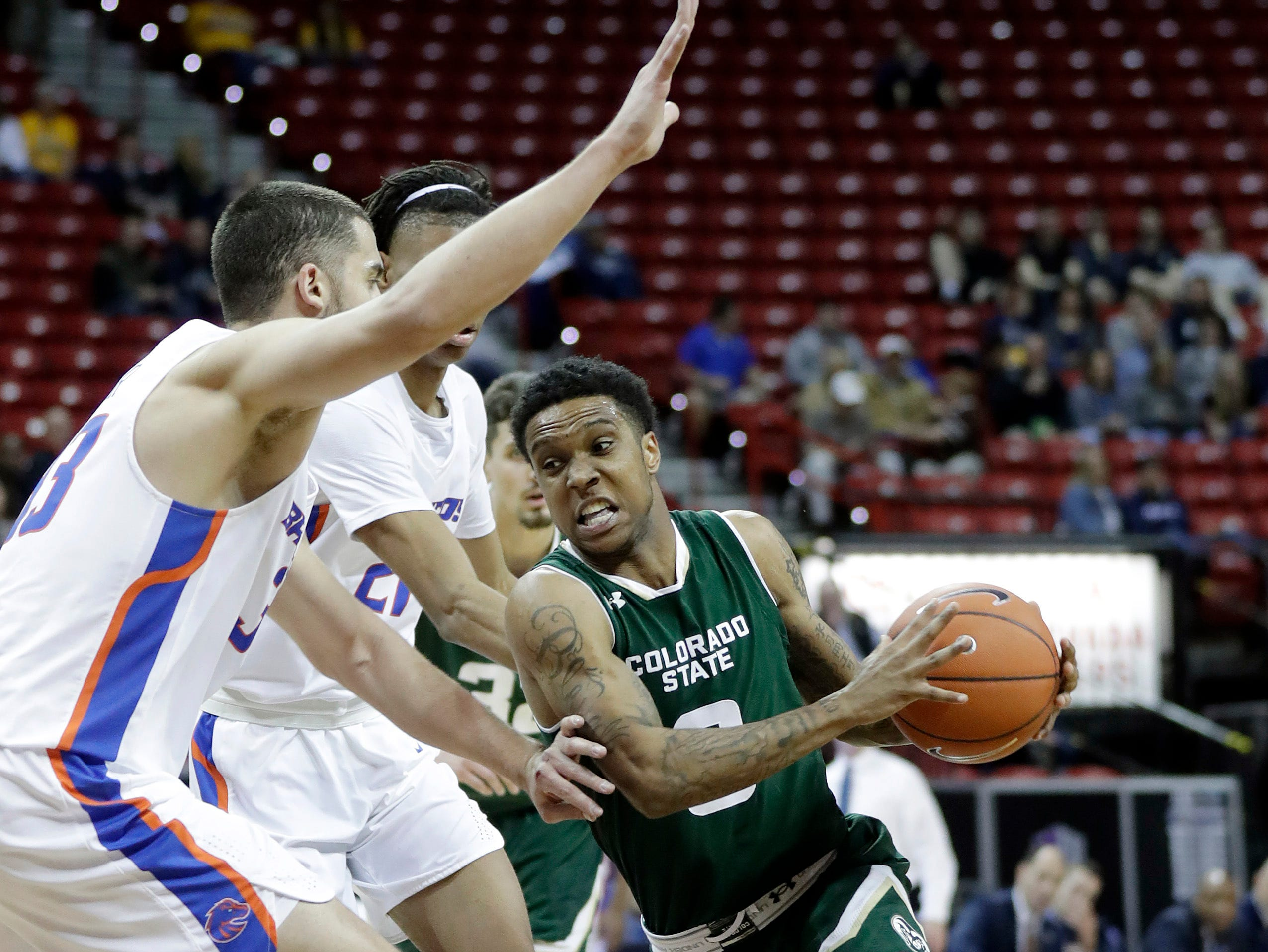 Colorado State's Hyron Edwards, right, drives against Boise State during the second half of an NCAA college basketball game in the Mountain West Conference tournament Wednesday, March 13, 2019, in Las Vegas.
