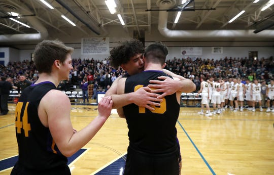 Denmark forward Jack Satori walks up to Brady Jens (facing camera) and Zane Short after the Vikings' sectional championship win over Freedom on Saturday.