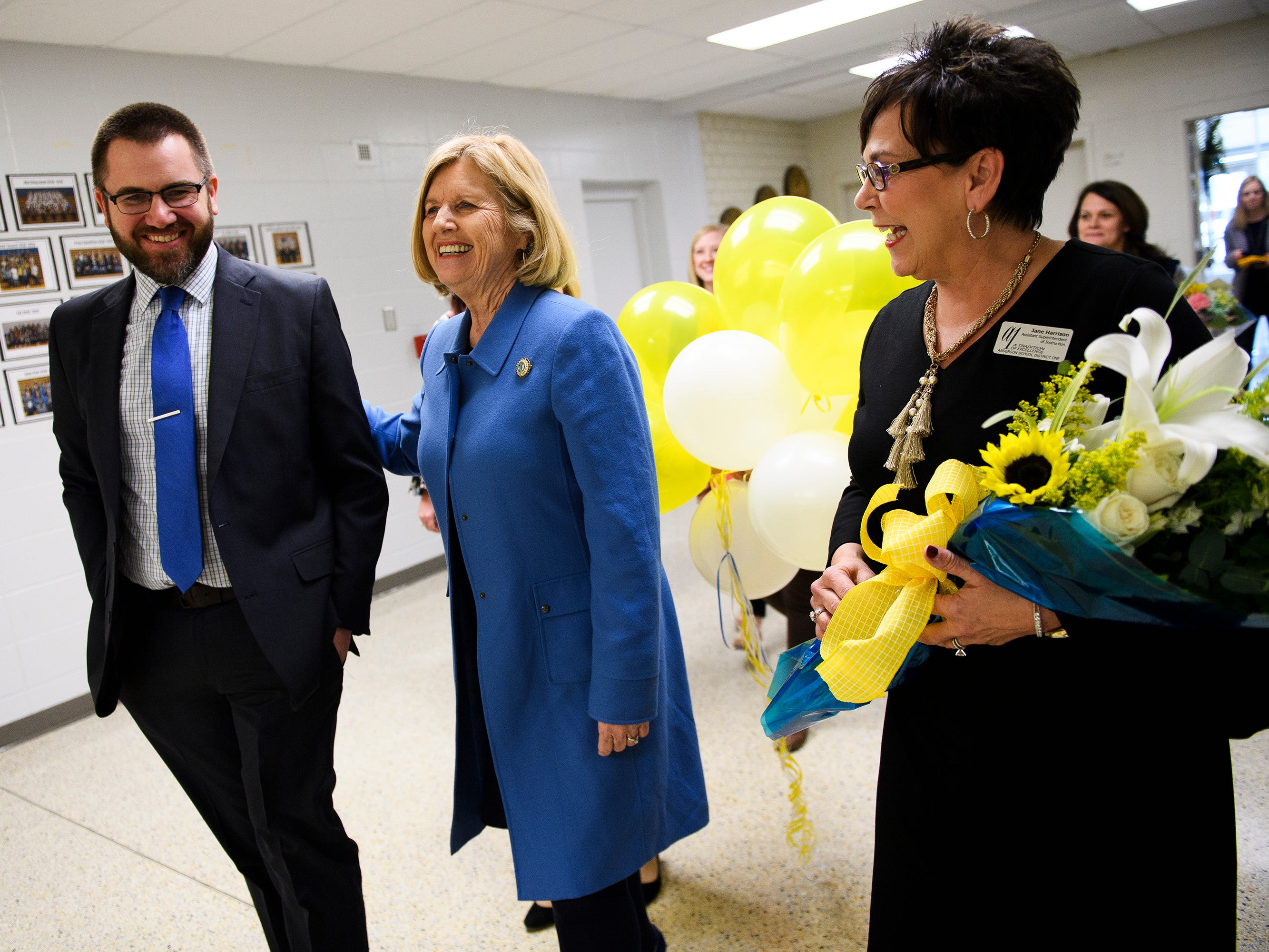 Superintendent of Education Molly Spearman, middle,  walks with Wren principal Seth Young left and Jane Harrison to surprise Tamara Cox with the announcement that she is a finalist for South Carolina Teacher of the Year Wednesday, March 13, 2019.