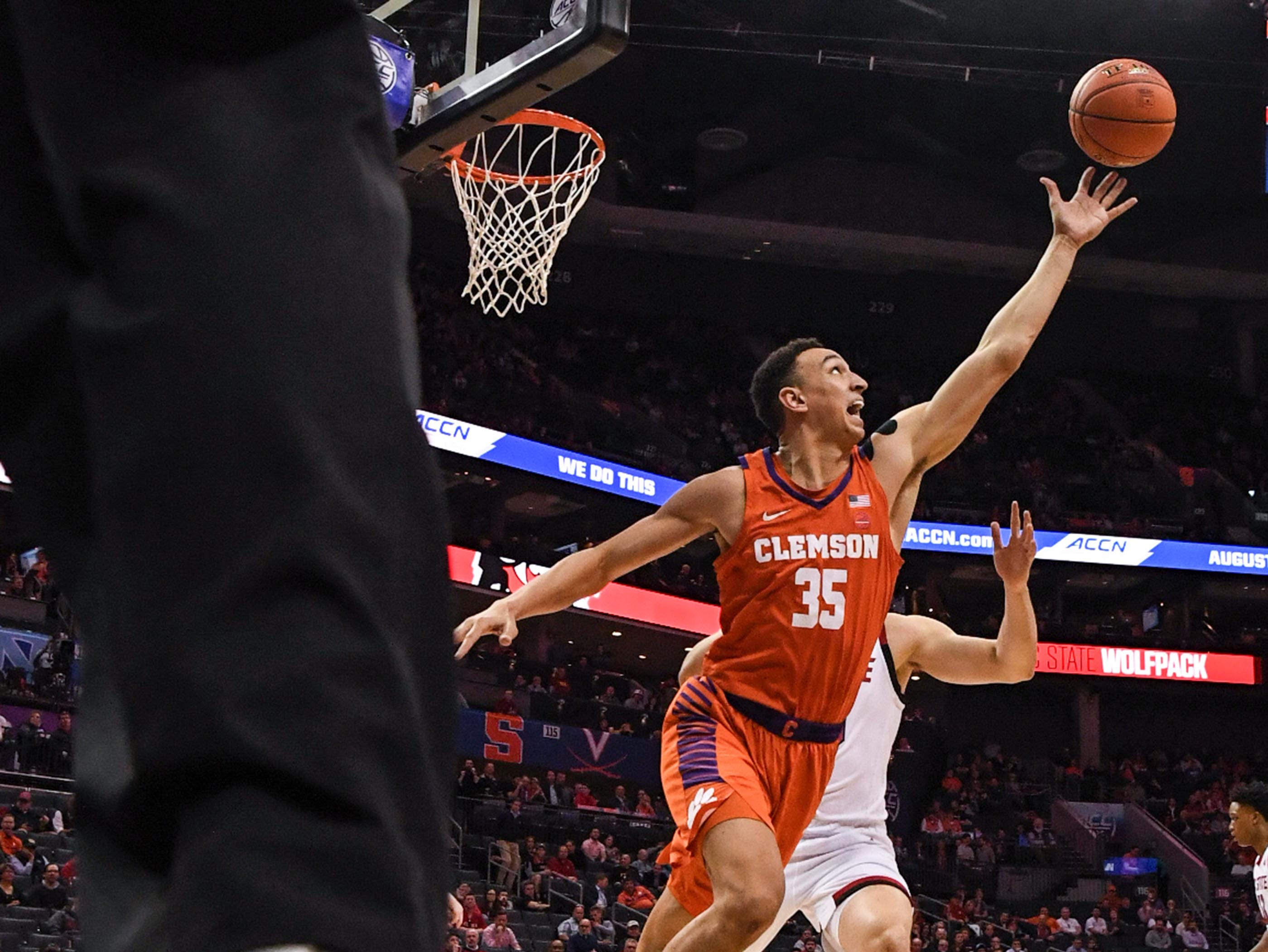 Clemson forward Javan White (35) reaches for a ball during the second half at the Spectrum Center in Charlotte, N.C. Tuesday, March 12, 2019.