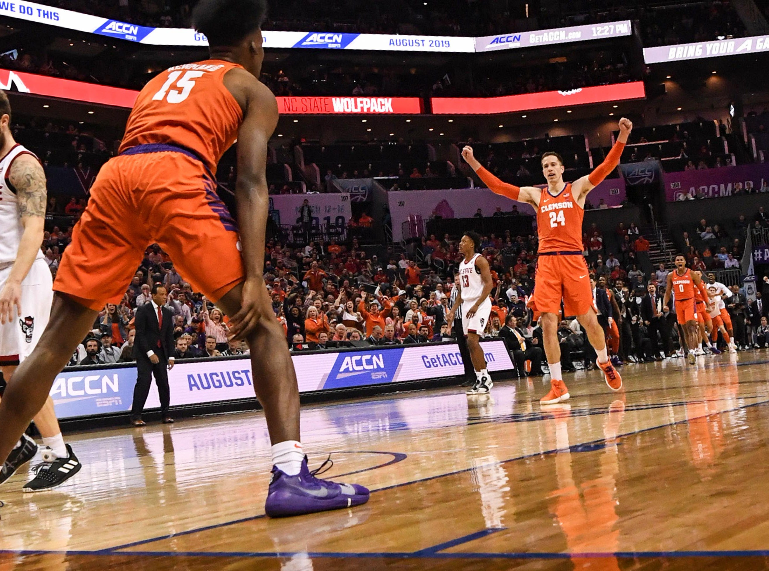 Clemson forward David Skara (24), right, celebrates after forward John Newman (15) dunked against N.C. State during the first half at the Spectrum Center in Charlotte, N.C. Tuesday, March 12, 2019.