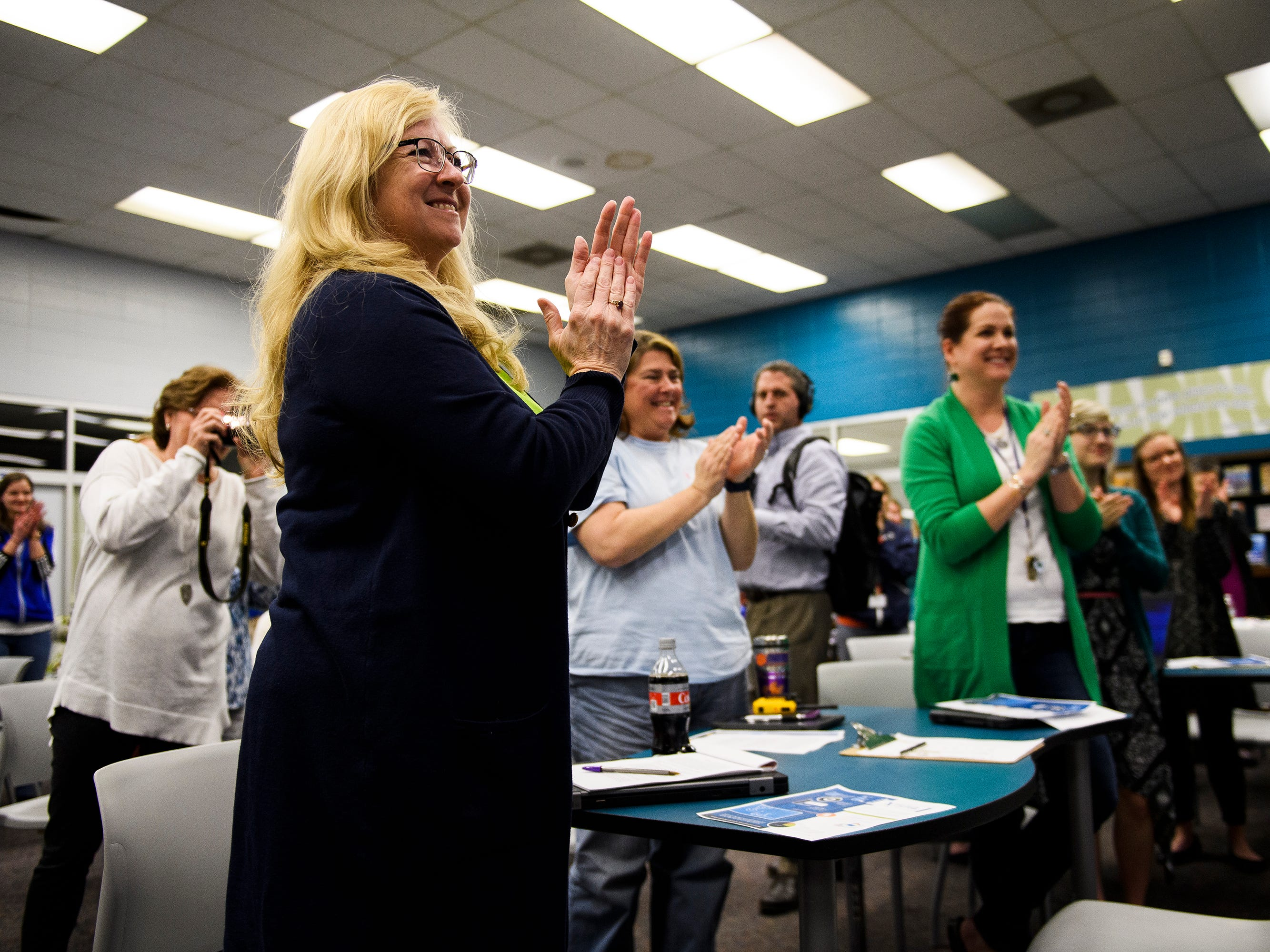 Teachers and faculty members at Wren High School applaud Tamara Cox after she is is named as one of five finalists for South Carolina Teacher of the Year Wednesday, March 13, 2019.