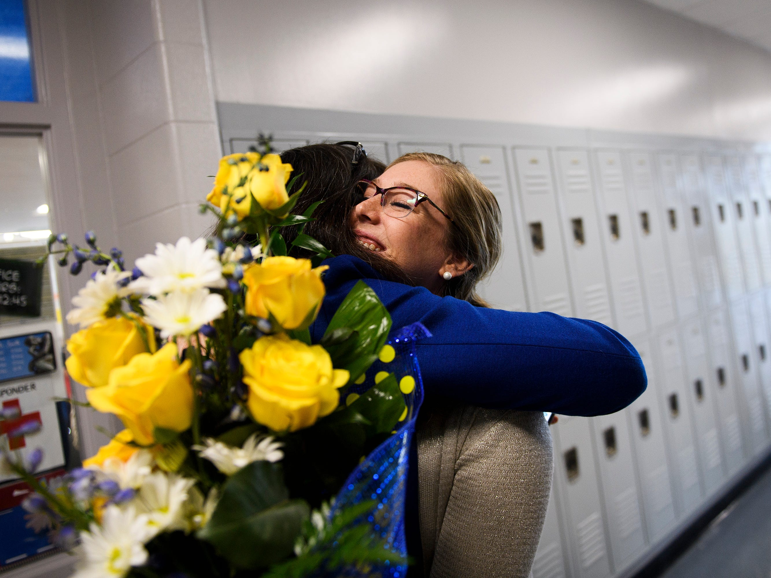 Shelley Smith hugs Teri Brinkman after it is announced she is one of five finalists for South Carolina Teacher of the Year at Travelers Rest High School Wednesday, March 13, 2019.