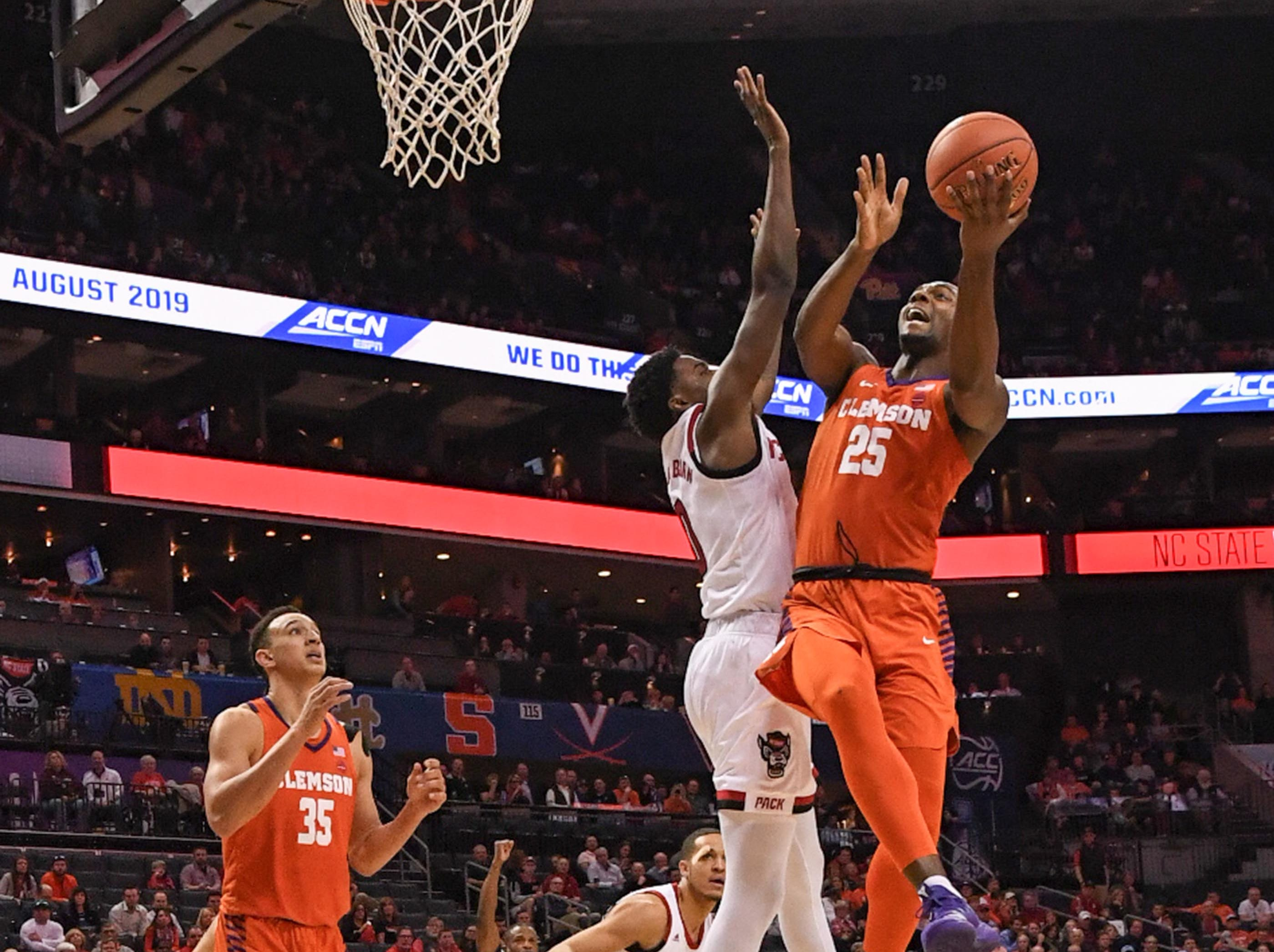 Clemson forward Aamir Simms (25) shoots against N.C. State during the second half at the Spectrum Center in Charlotte, N.C. Tuesday, March 12, 2019.