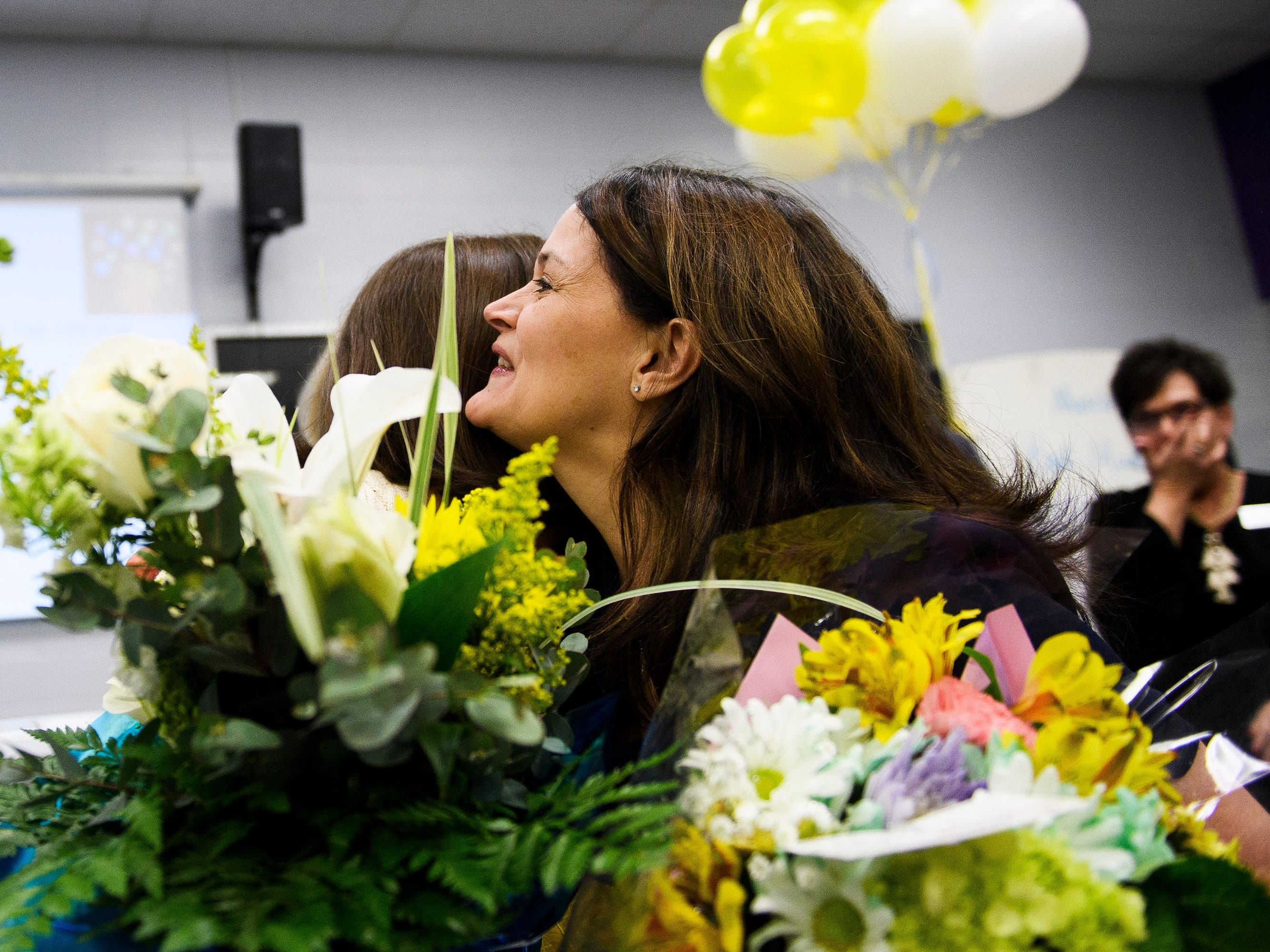 Wendy Burgess, Anderson 1 school board trustee, hugs Tamara Cox after she is named as one of five finalists for South Carolina Teacher of the Year at Wren High School Wednesday, March 13, 2019.