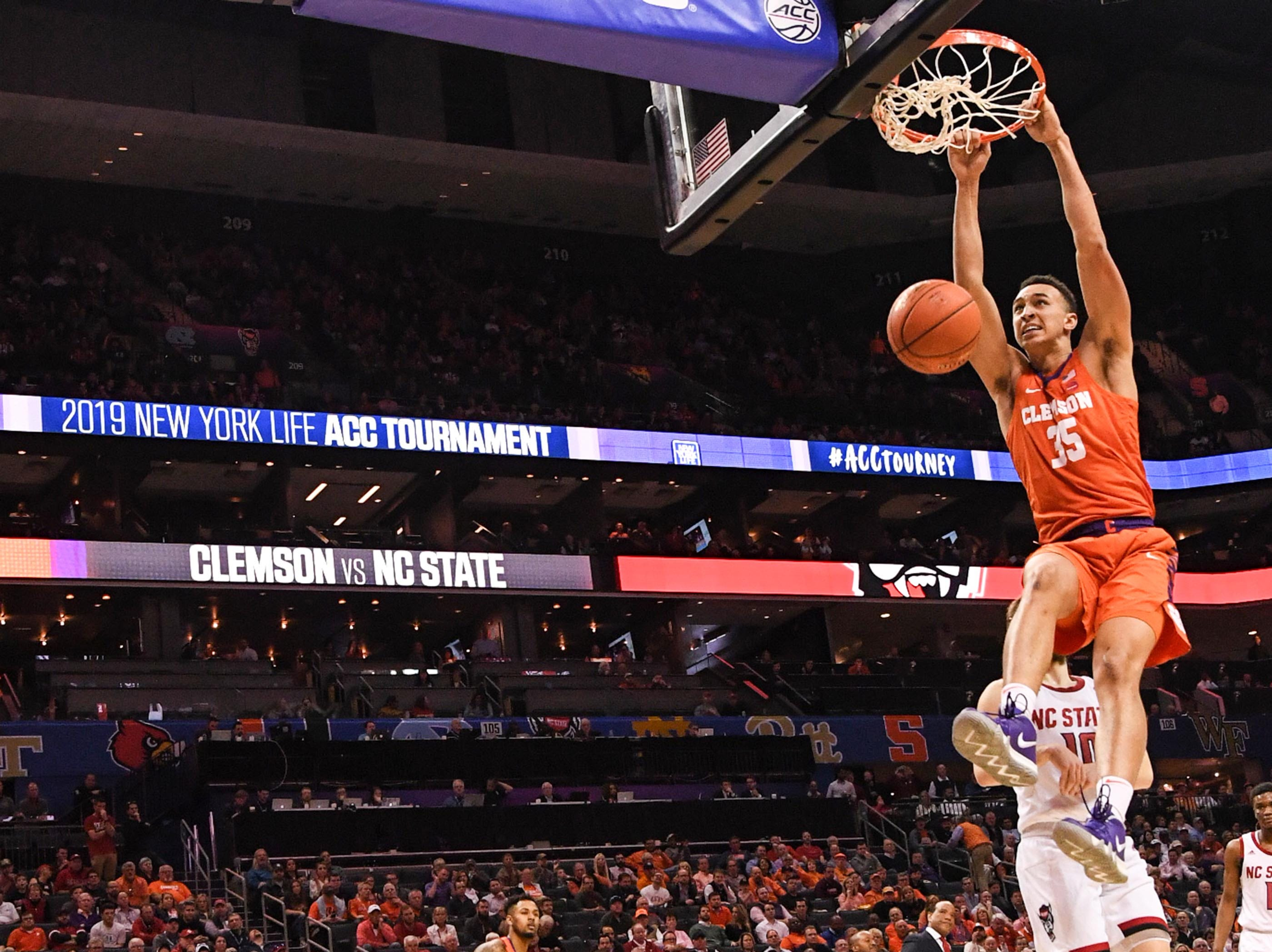 Clemson forward Javan White (35) dunks against N.C. State during the first half at the Spectrum Center in Charlotte, N.C. Tuesday, March 12, 2019.