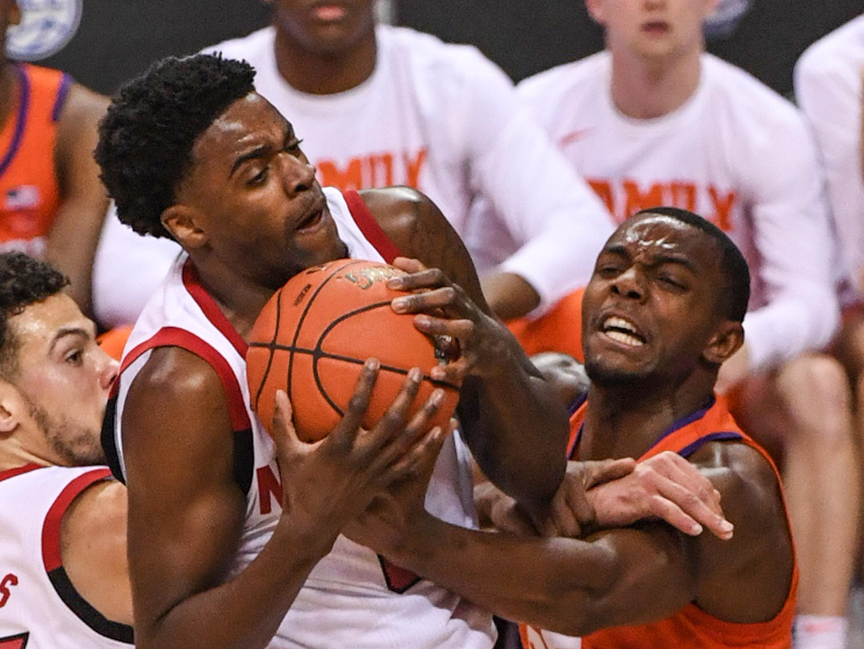 N.C. State guard Torin Dorn(2) rebounds near Clemson forward Aamir Simms (25) during the second half at the Spectrum Center in Charlotte, N.C. Tuesday, March 12, 2019.