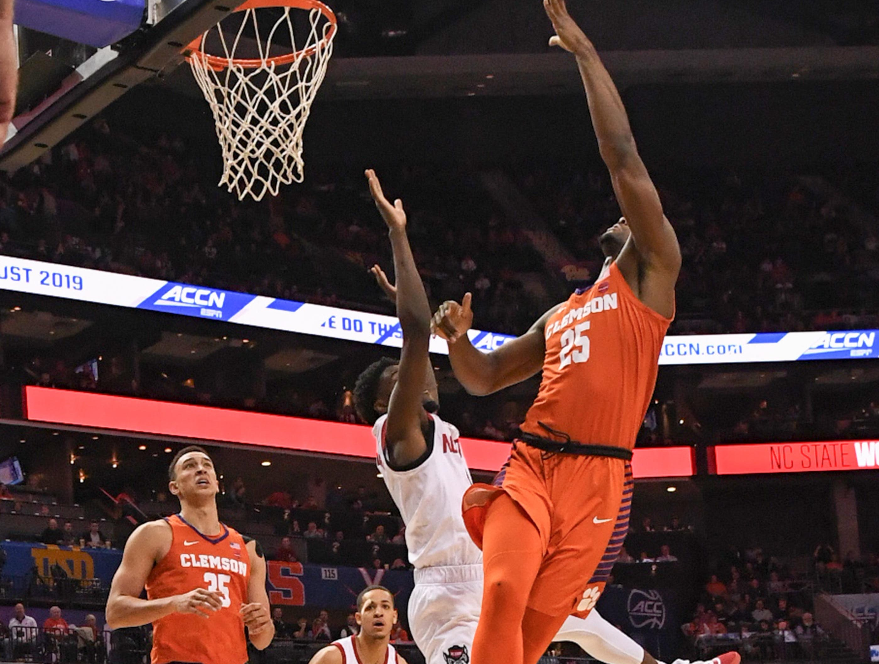 Clemson forward Aamir Simms (25) shoots during the second half at the Spectrum Center in Charlotte, N.C. Tuesday, March 12, 2019.