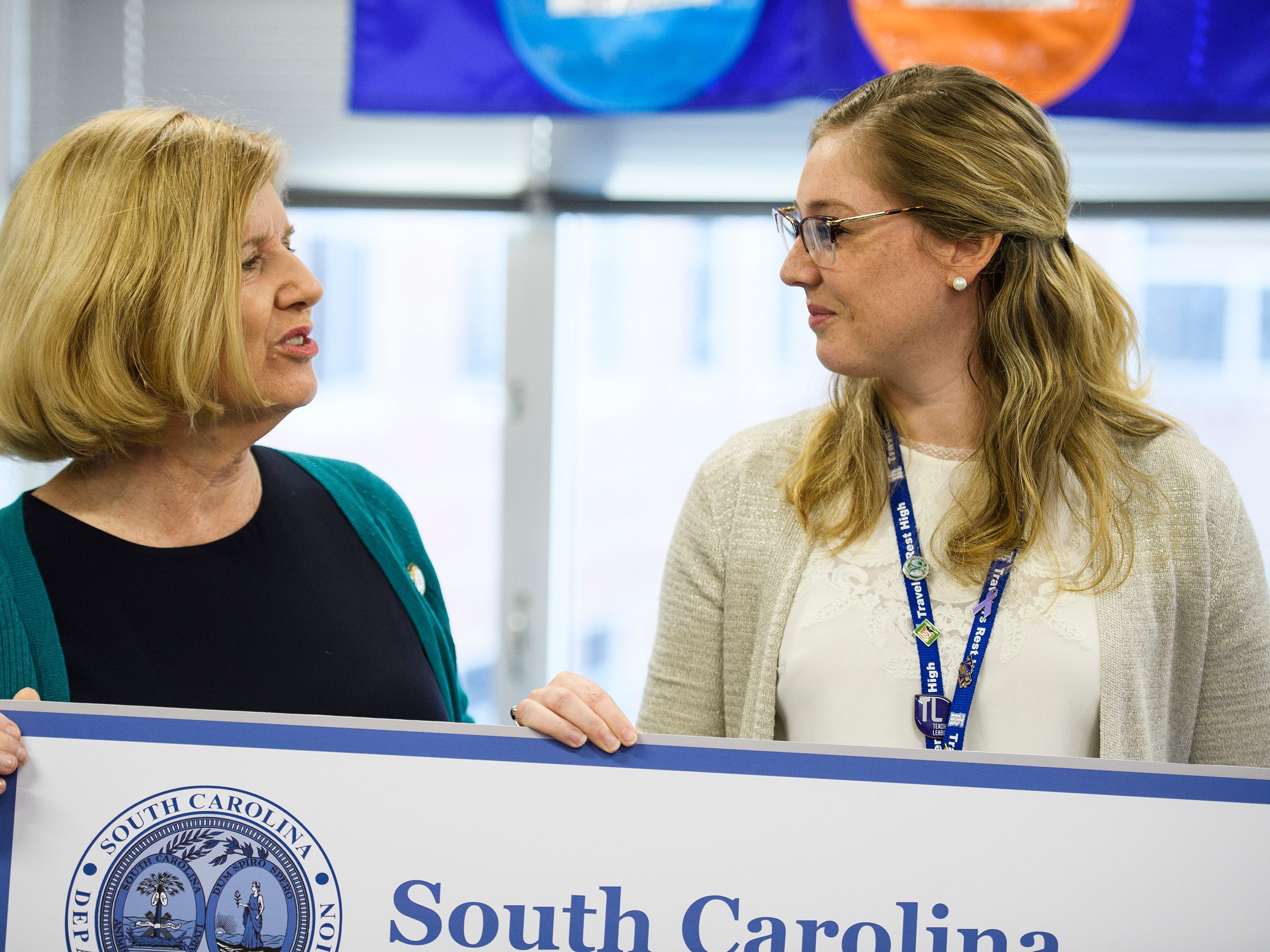 Superintendent of Education Molly Spearman presents Shelley Smith with a check in her classroom after Smith was announced to be one of five South Carolina Teacher of the Year finalists at Travelers Rest High School Wednesday, March 13, 2019.