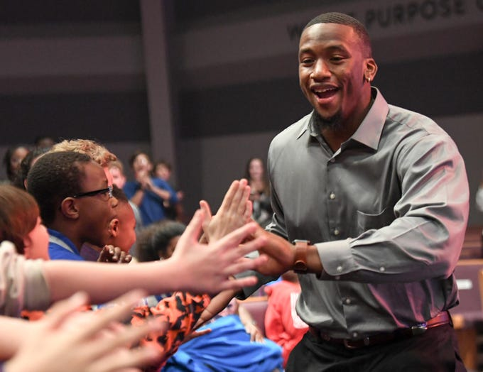 Clelin Ferrell, former Clemson Tigers, greets fans attending  the Coaches 4 Character event at Relentless Church in Greenville Tuesday.