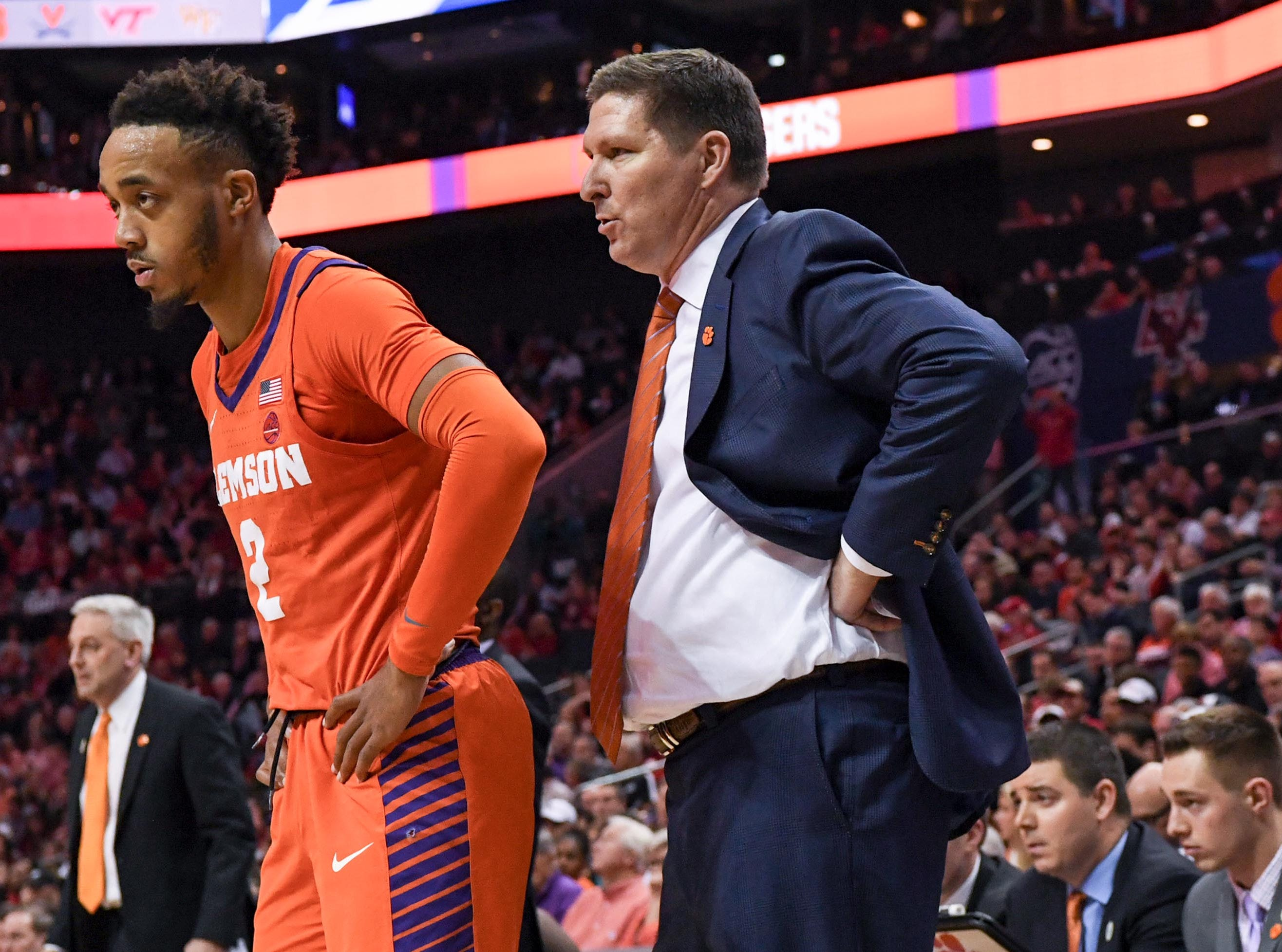 Clemson guard Marcquise Reed (2) and Clemson head coach Brad Brownell  watch during the second half at the Spectrum Center in Charlotte, N.C. Tuesday, March 12, 2019.