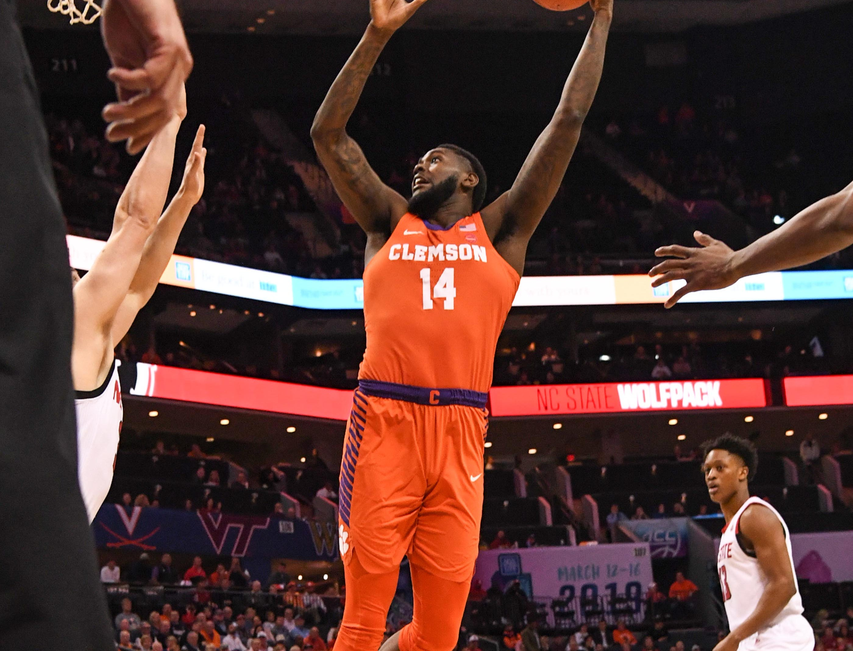 Clemson forward Elijah Thomas (14) shoots during the first half at the Spectrum Center in Charlotte, N.C. Tuesday, March 12, 2019.