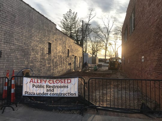 A construction team works on an alley across from the Ice Cream Station in downtown Simpsonville, where the city is planning a public plaza and restrooms. The site is pictured on Tuesday, March 12, 2019.