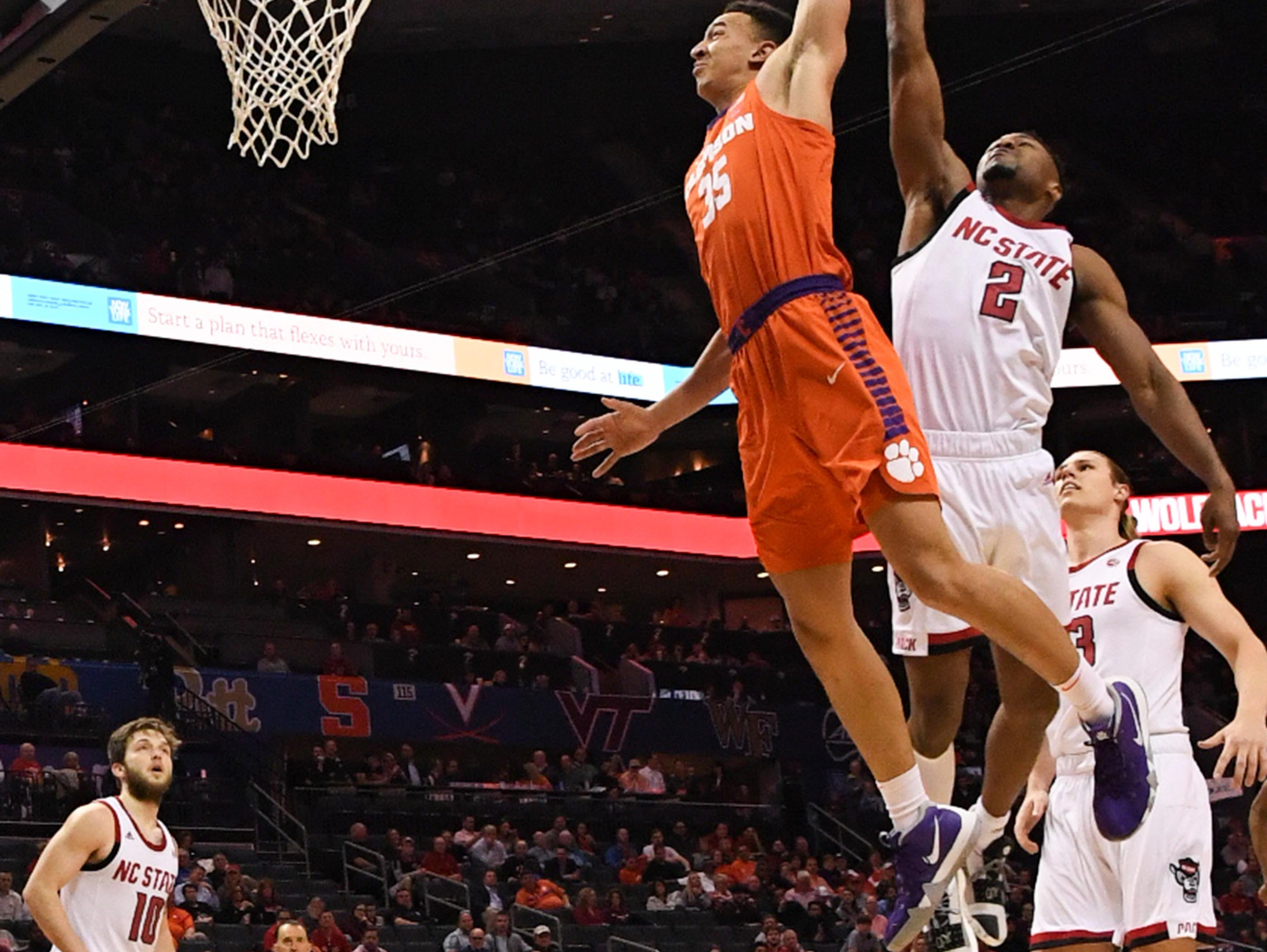 Clemson forward Javan White (35) dunks near N.C. State guard Torin Dorn(2) during the second half at the Spectrum Center in Charlotte, N.C. Tuesday, March 12, 2019.