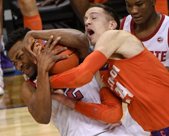 N.C. State guard Torin Dorn(2) gets a rebound near Clemson forward David Skara (24) during the second half at the Spectrum Center in Charlotte, N.C. Tuesday, March 12, 2019.