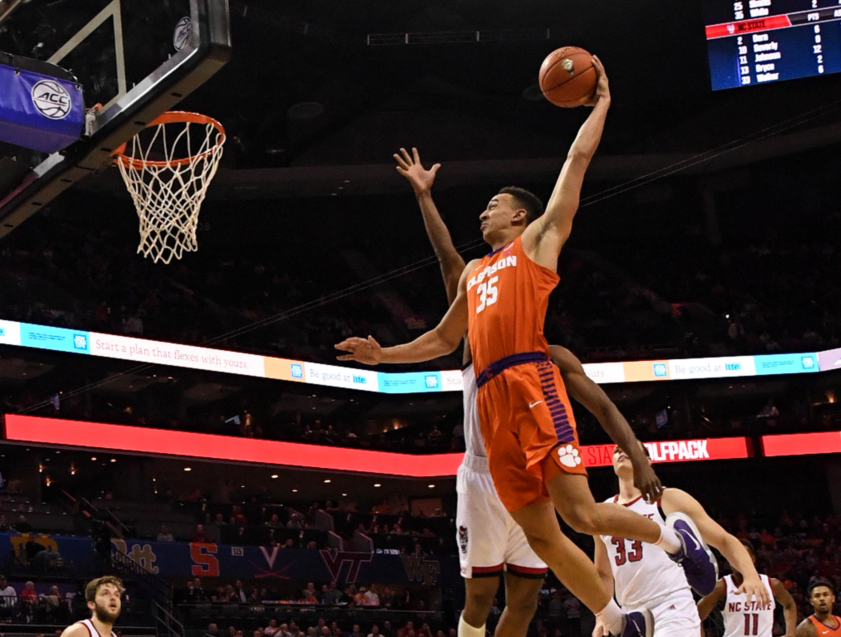 Clemson forward Javan White (35) dunks during the second half at the Spectrum Center in Charlotte, N.C. Tuesday, March 12, 2019.