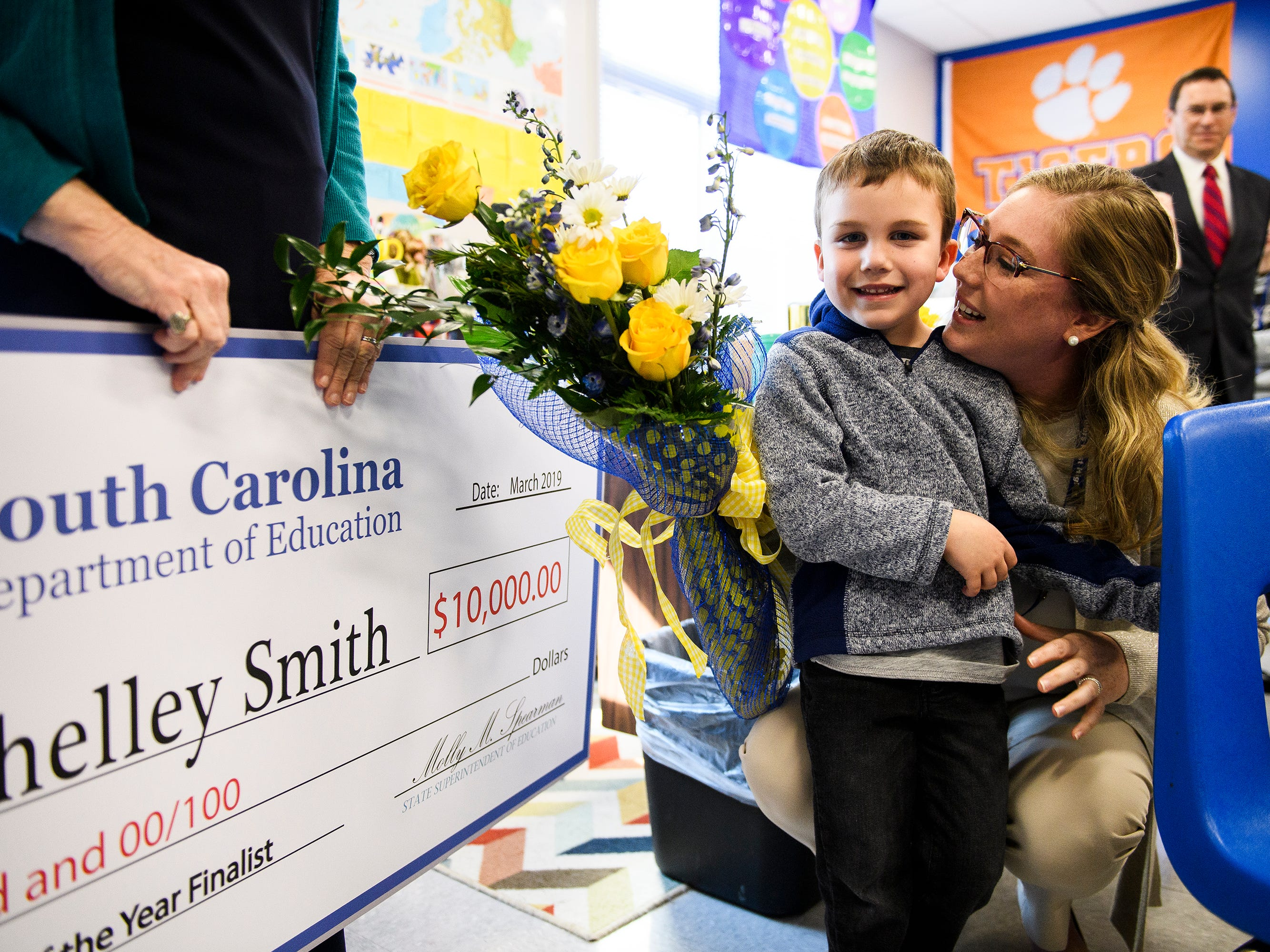 Shelley Smith hugs her son Aiden Britt, 5, after it is announced she is one of five finalists for South Carolina Teacher of the Year at Travelers Rest High School Wednesday, March 13, 2019.