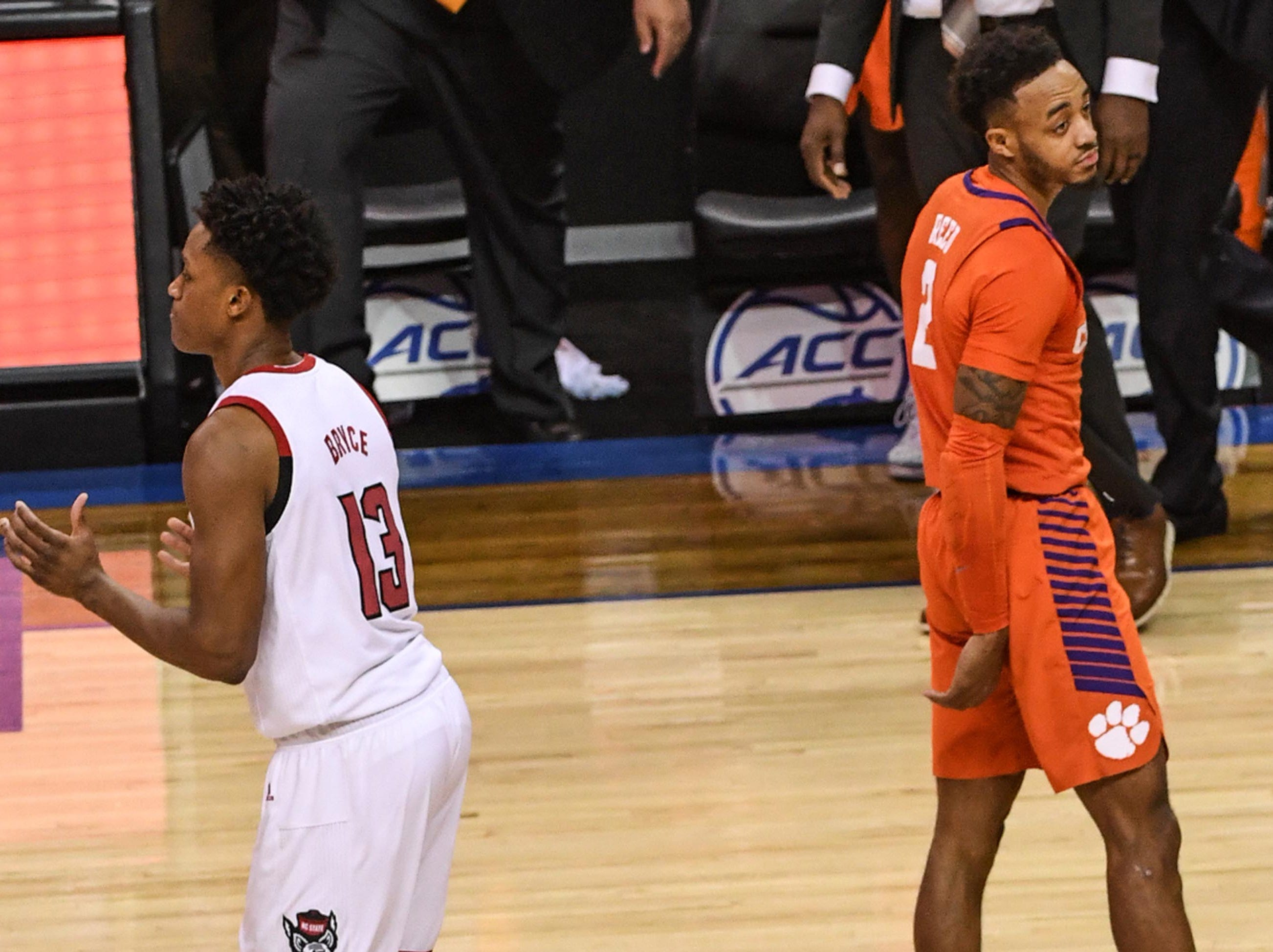 Clemson guard Marcquise Reed (2) and N.C. State guard C.J. Bryce(13) walk off the court after the game at the Spectrum Center in Charlotte, N.C. Tuesday, March 12, 2019. N.C. State won 59-58.