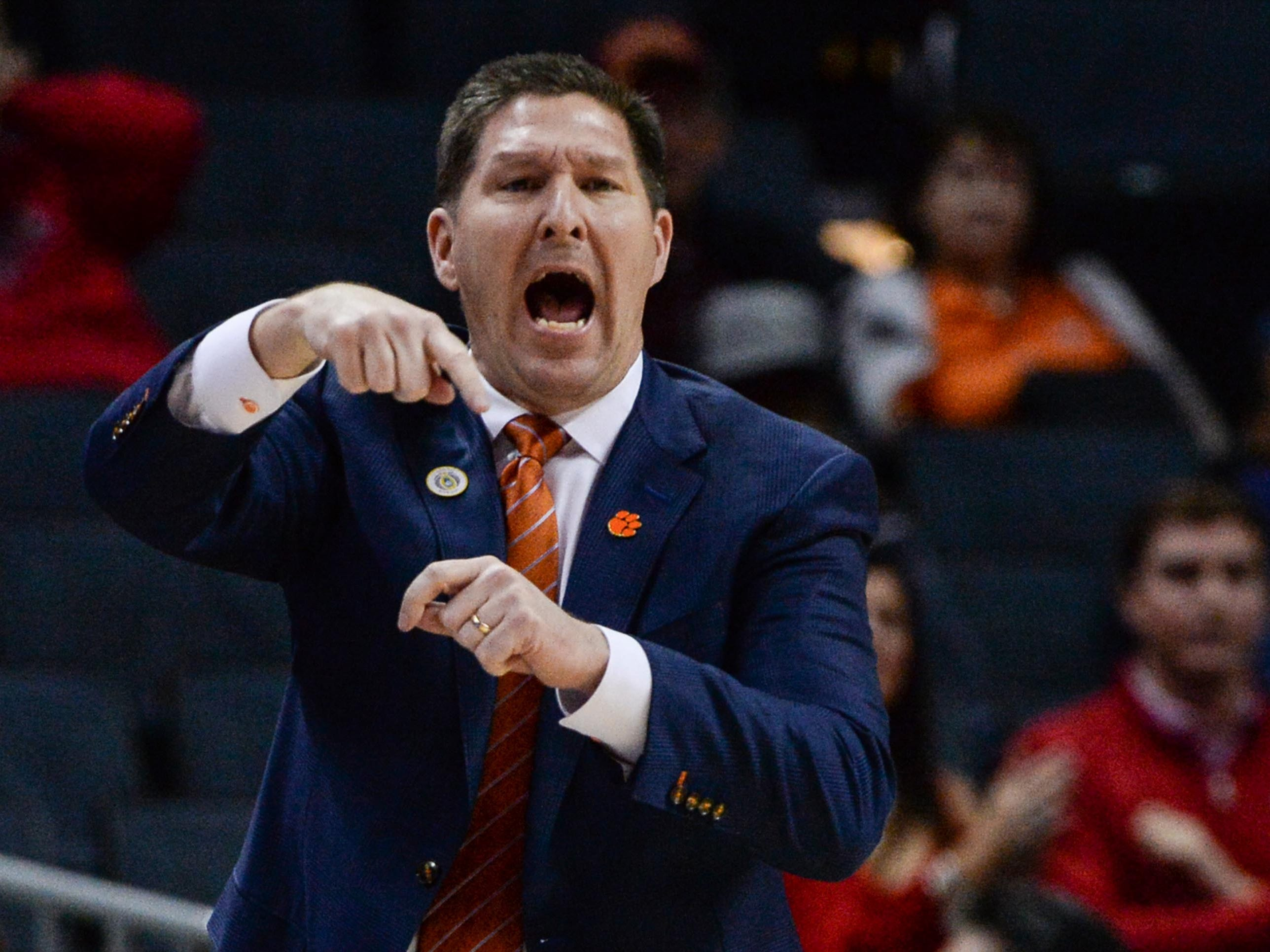 Clemson head coach Brad Brownell  communicates with his team playing N.C. State during the first half at the Spectrum Center in Charlotte, N.C. Tuesday, March 12, 2019.