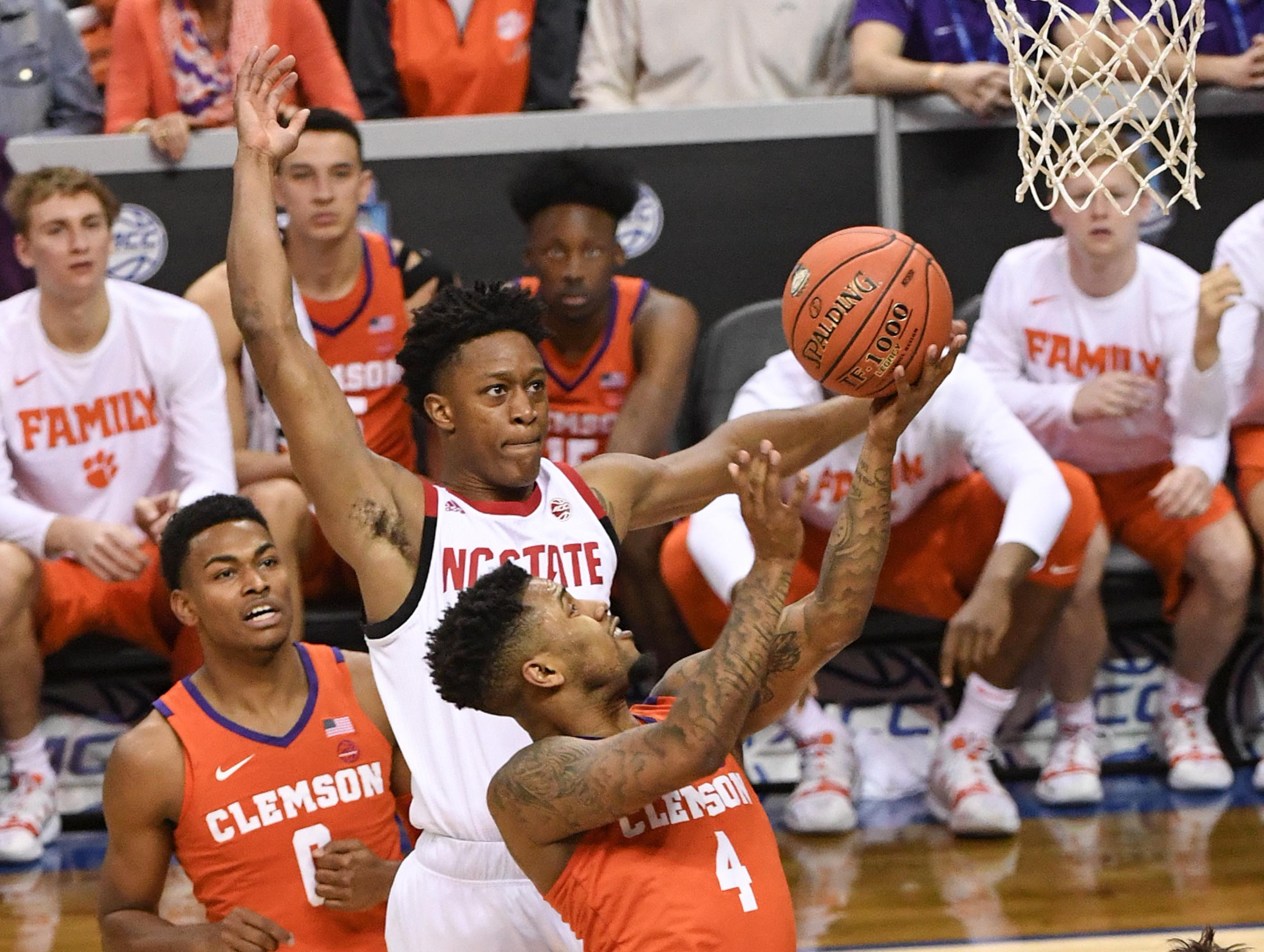Clemson guard Shelton Mitchell (4) has a shot blocked by N.C. State guard C.J. Bryce(13) during the second half at the Spectrum Center in Charlotte, N.C. Tuesday, March 12, 2019.