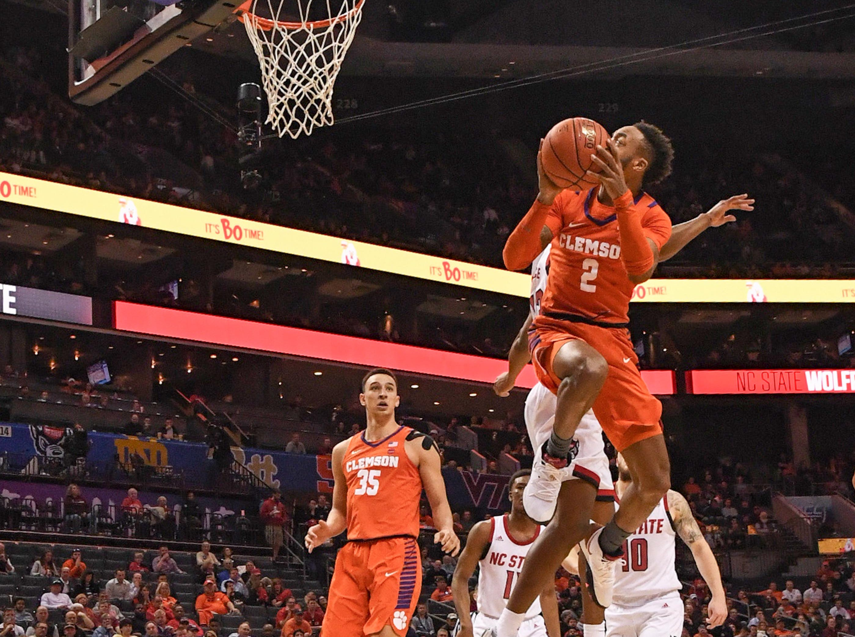 Clemson guard Marcquise Reed (2) shoots against N.C. State during the second half at the Spectrum Center in Charlotte, N.C. Tuesday, March 12, 2019.