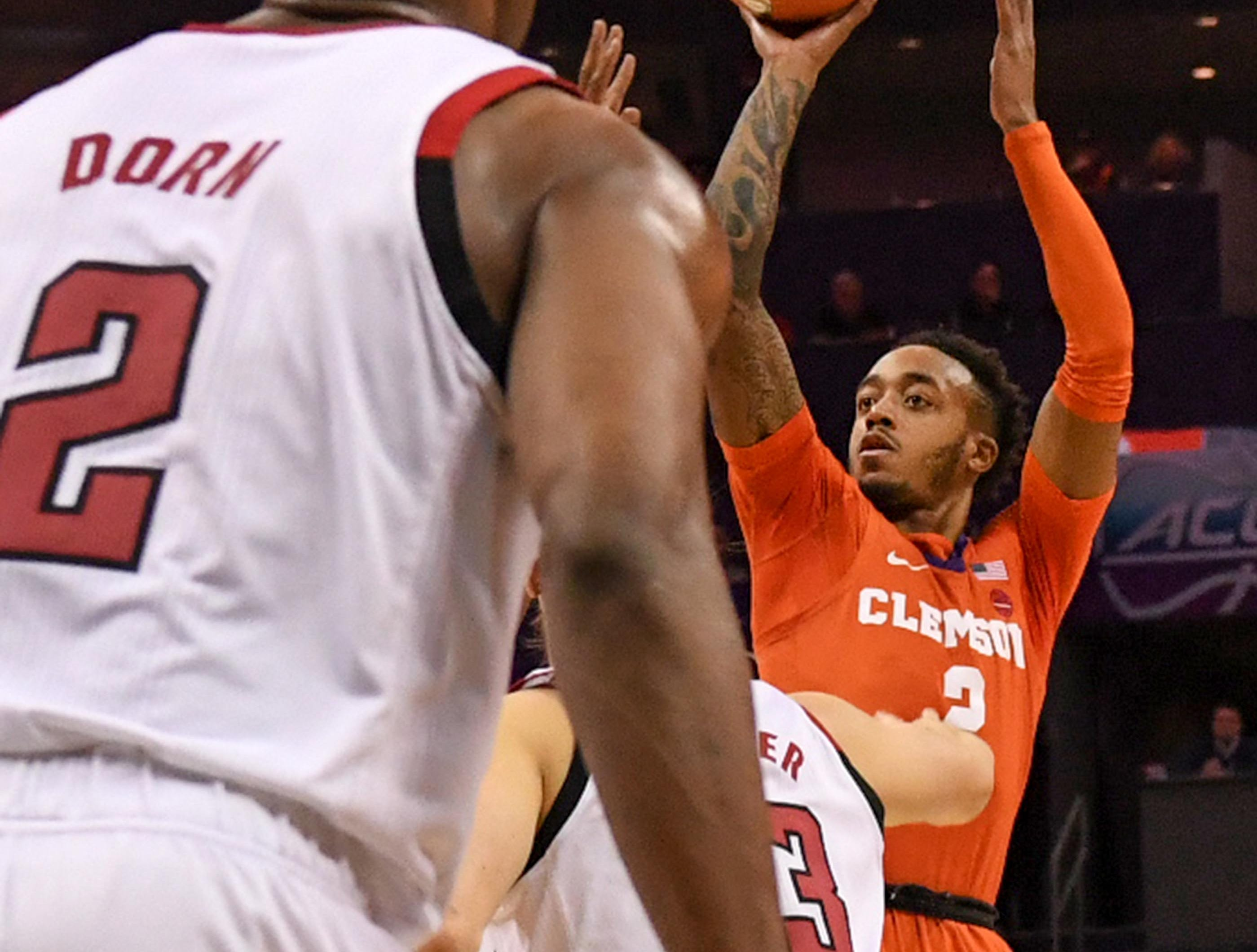 Clemson guard Marcquise Reed (2) shoots near N.C. State guard Torin Dorn(2) during the first half at the Spectrum Center in Charlotte, N.C. Tuesday, March 12, 2019.