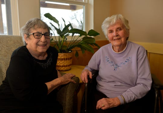 Edith Guza, right, with her friend Audrey Hauger at The Lodge senior living community.  Guza will turn 100 on March 17th.