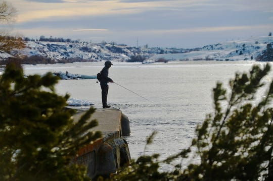 Theodore Skinner fishes at Giant Spring State Park Tuesday. Temperatures are expected to reach the 40s next week.