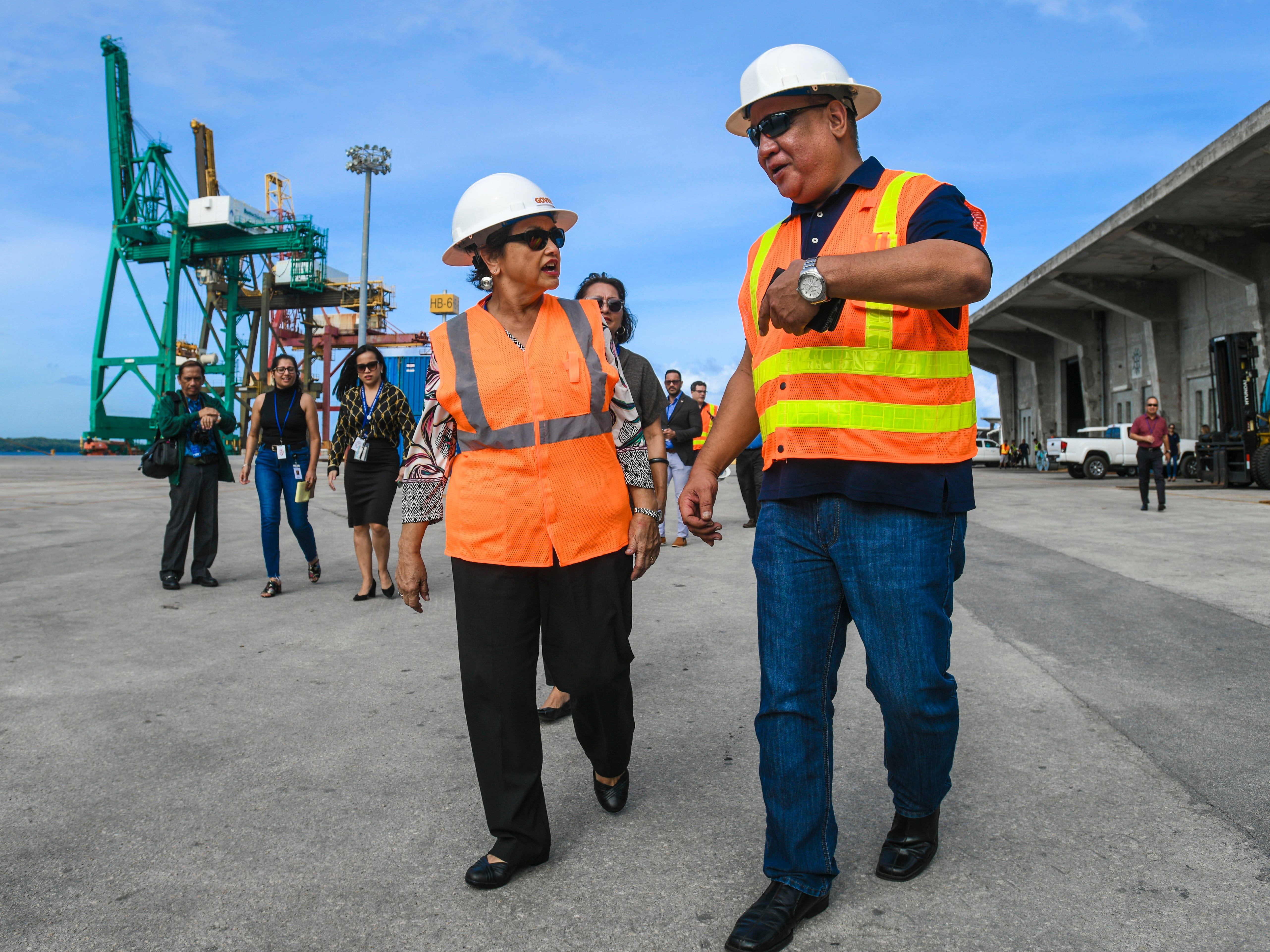 Gov. Lou Leon Guerrero talks with Operations Manager John Santos as she, Lt. Gov. Josh Tenorio and others, tour the Jose D. Leon Guerrero Commercial Port in Piti on Wednesday, March 13, 2019.