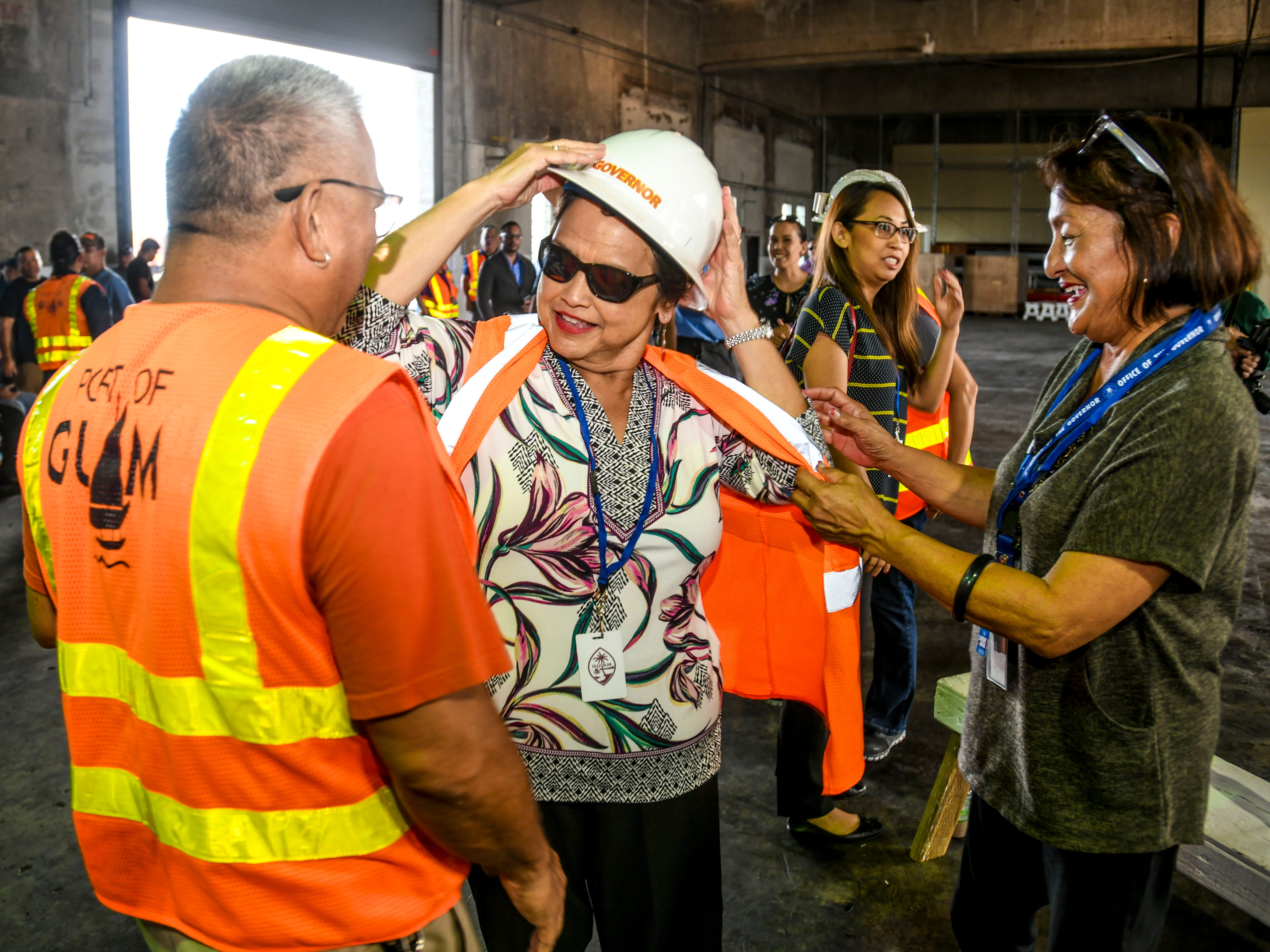 After meeting with a group of port employees, Gov. Lou Leon Guerrero dons a hard hat and safety vest prior to visiting the dockside of the Jose D. Leon Guerrero Commercial Port in Piti on Wednesday, March 13, 2019.
