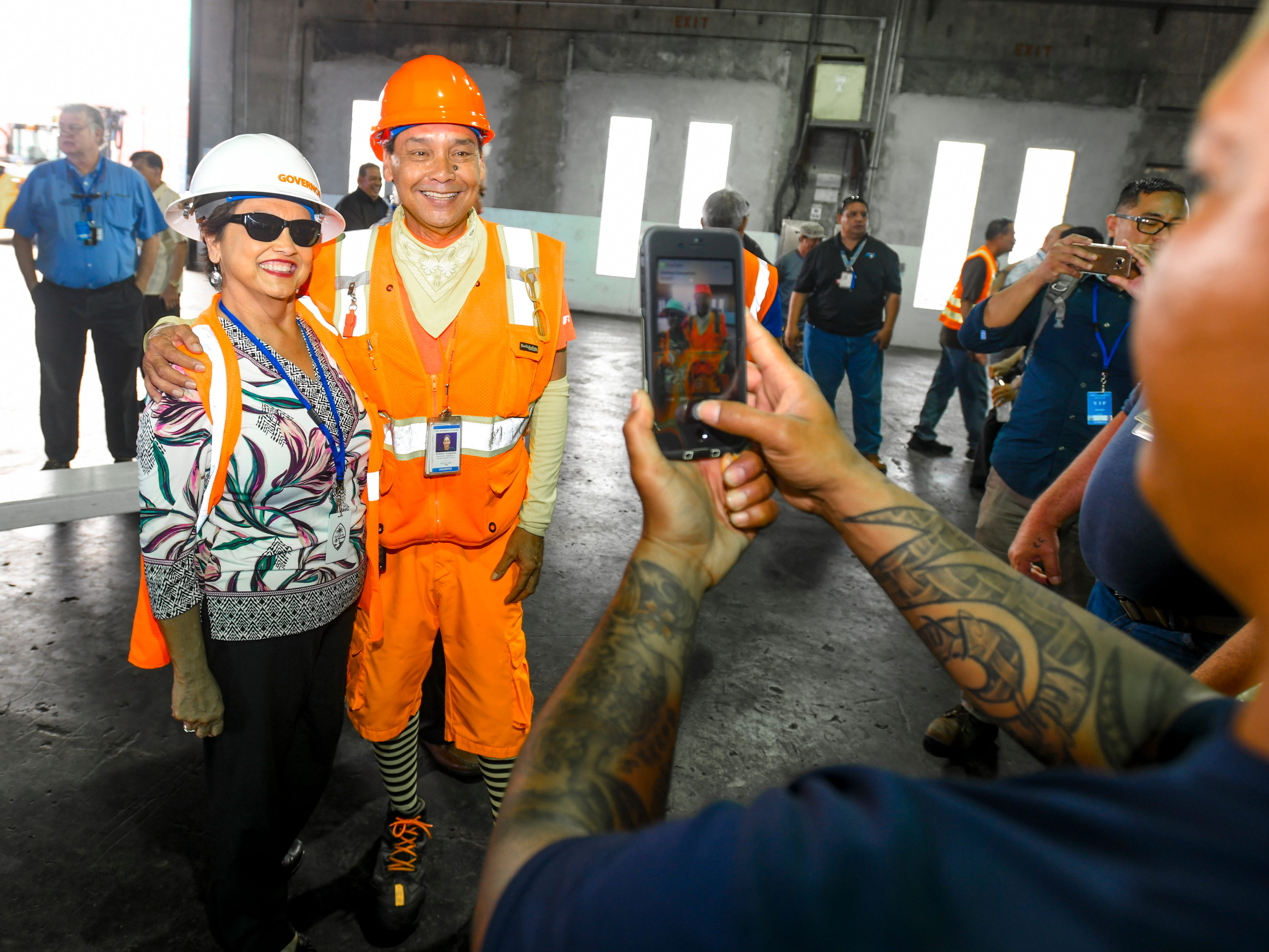 Equipment operator Anthony Evangelista takes the opportunity to have a photo taken with Gov. Lou Leon Guerrero during a tour by Leon Guerrero, Lt. Gov. Josh Tenorio and others, at the Jose D. Leon Guerrero Commercial Port in Piti on Wednesday, March 13, 2019.