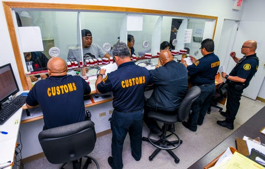 Customs officers assist customers in attaining their clearances at the Jose D. Leon Guerrero Commercial Port in Piti on Wednesday, March 13, 2019.